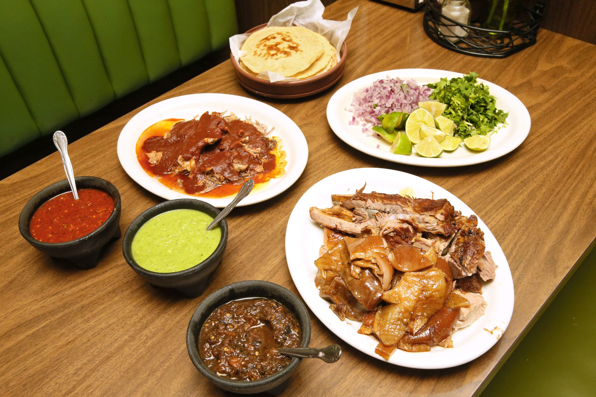 You can dine family style at Carnitas Don Lucho, 565 W. Lincoln Ave., a weekends-only restaurant. The meal includes salsas (roja, tota and molcajete are shown from left), a choice of meat such as lamb in red sauce or carnitas (fried pork), plus onions, cilantro, lime and handmade tortillas.