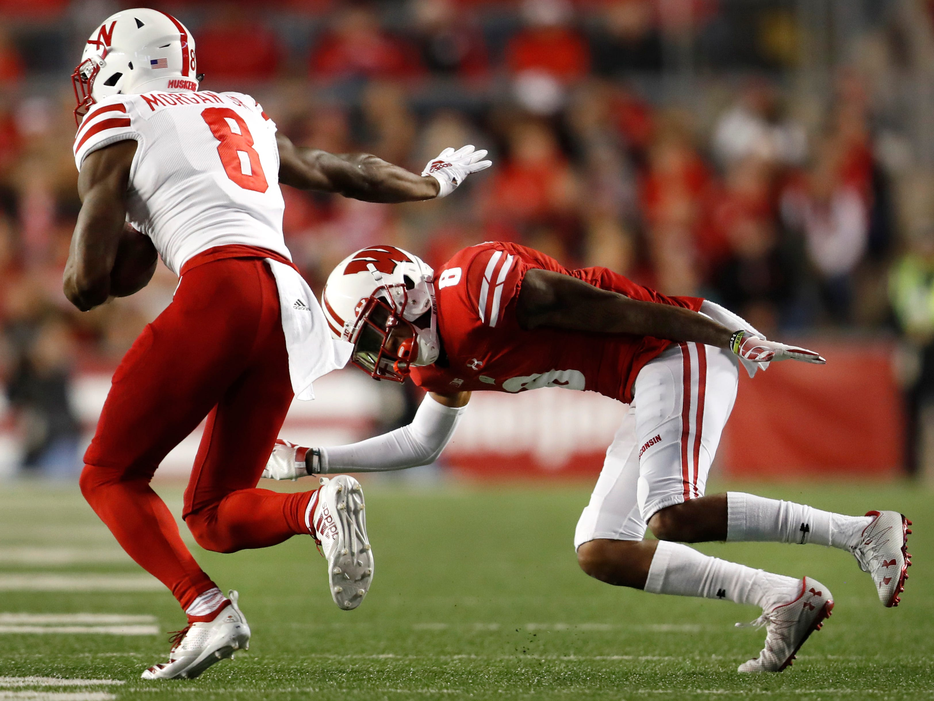Nebraska wide receiver Stanley Morgan Jr. tries to work his way around Wisconsin cornerback Deron Harrell on Saturday night.