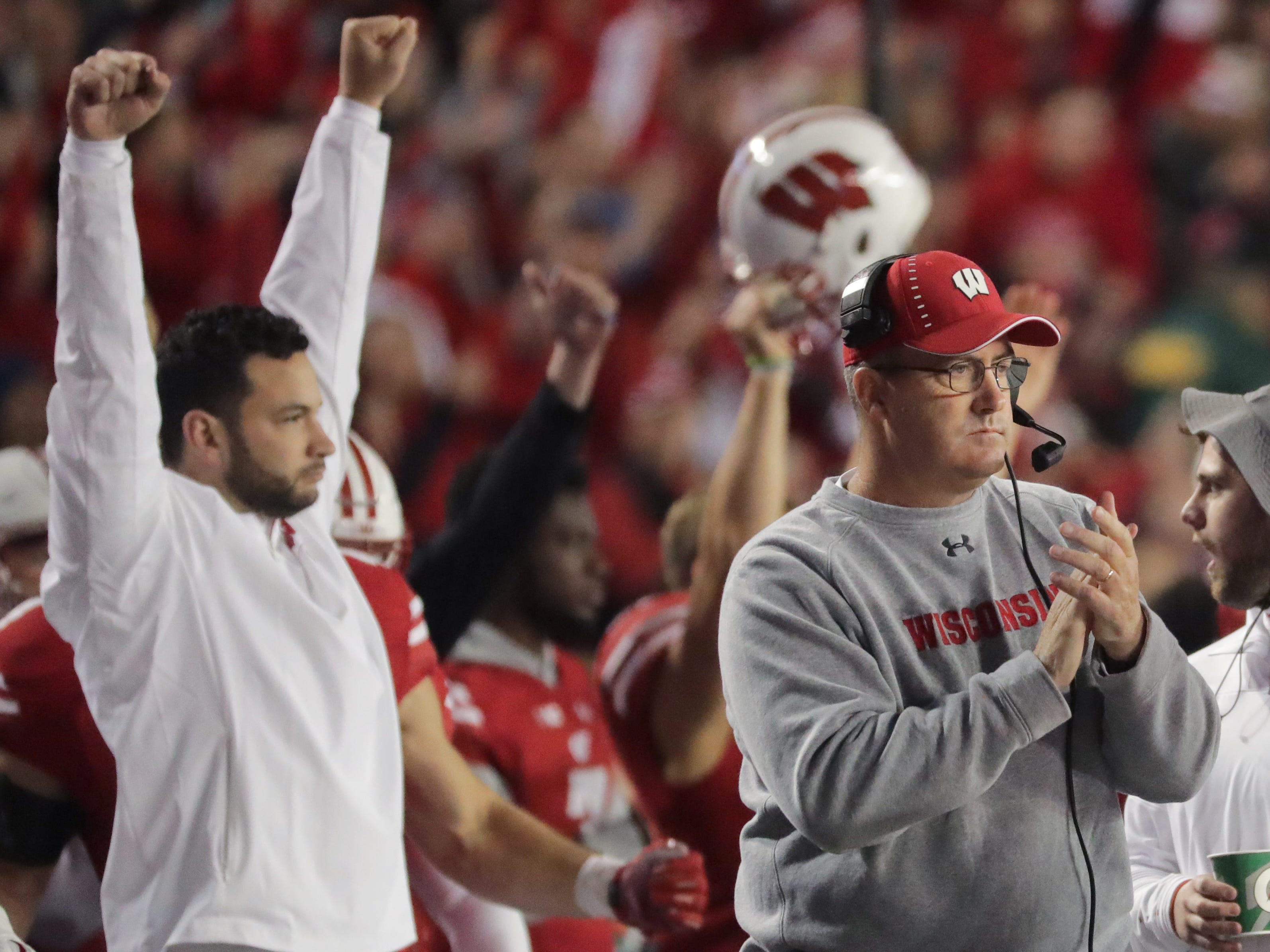 Badgers head coach Paul Chryst (right) reacts after a review showed that running back Jonathan Taylor scored a touchdown during the second quarter against Nebraska on Saturday night.