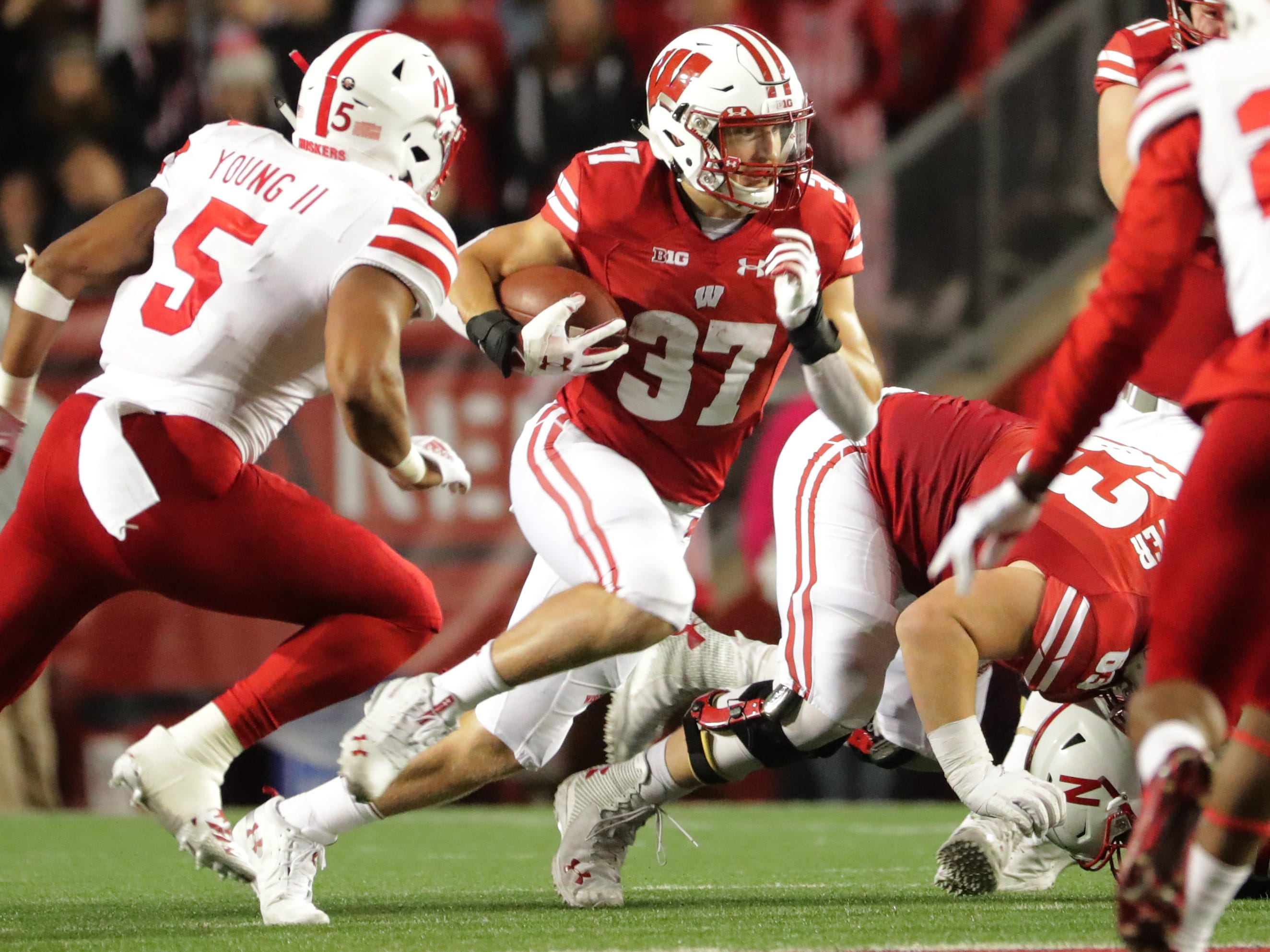Wisconsin's offensive line provides running back Garrett Groshek a nice hole to run through in Nebraska's defense during the second quarter on Saturday night.