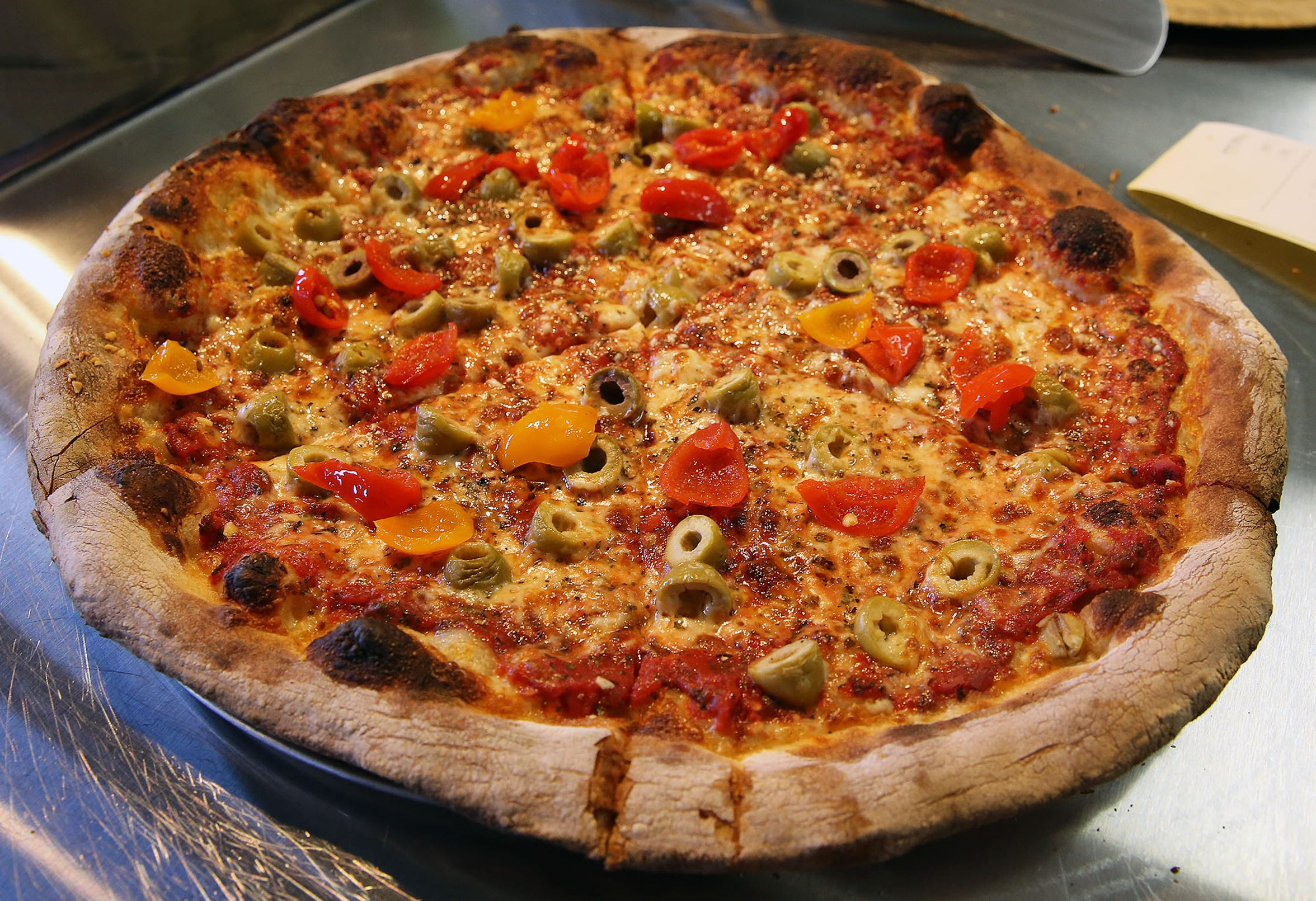 The Loowit at Wy'east Pizza, 5601 W. Vliet St., combines green olives and sweet-hot peppers.