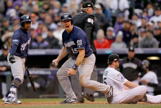 Erik Kratz celebrates after scoring a run in the sixth inning on a wild pitch.