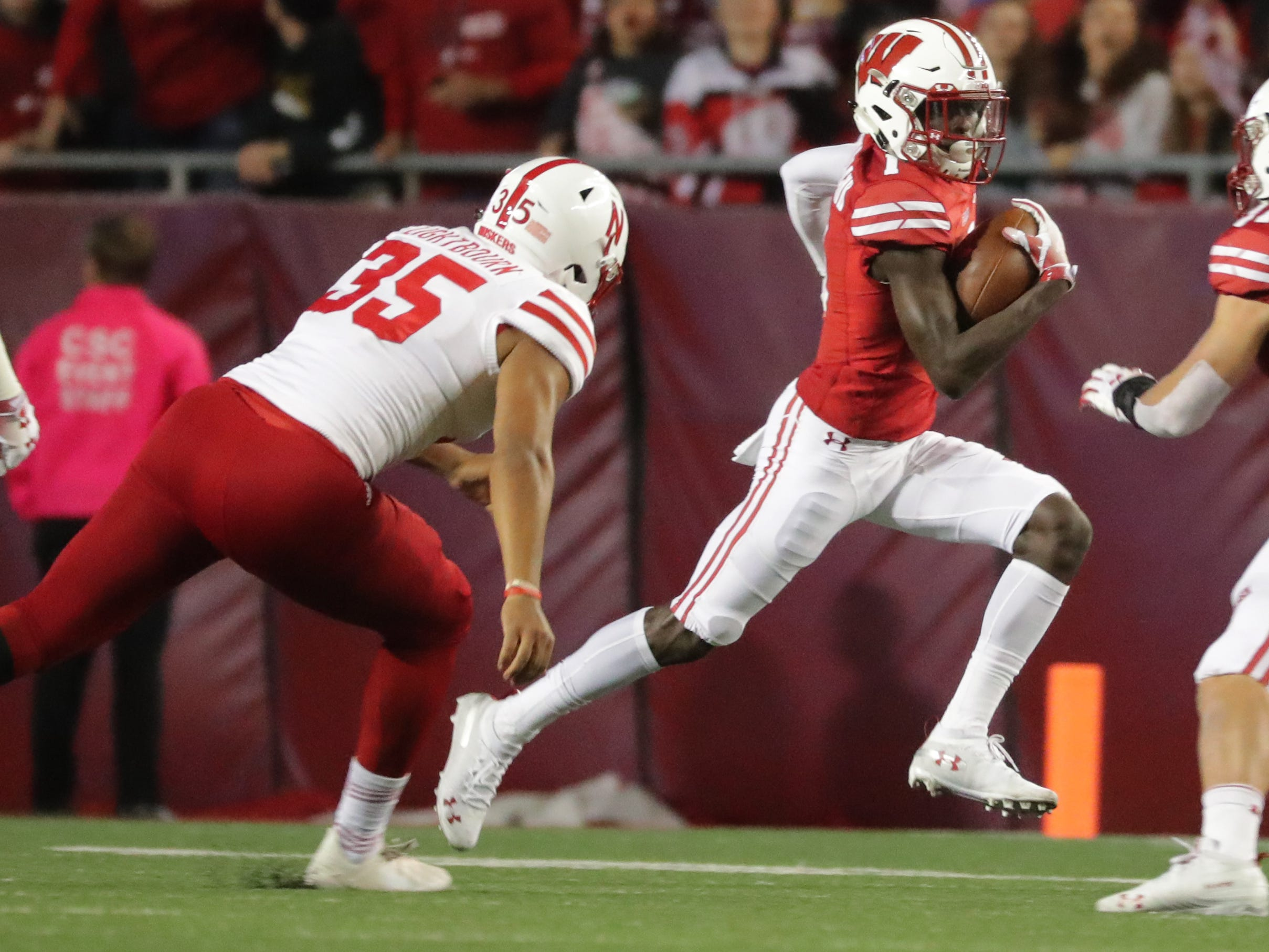 Nebraska kicker Caleb Lightbourn is able to clip to heel of Aron Cruickshank of the Badgers for a touchdown saving tackle on a kickoff return during the second quarter Saturday night.