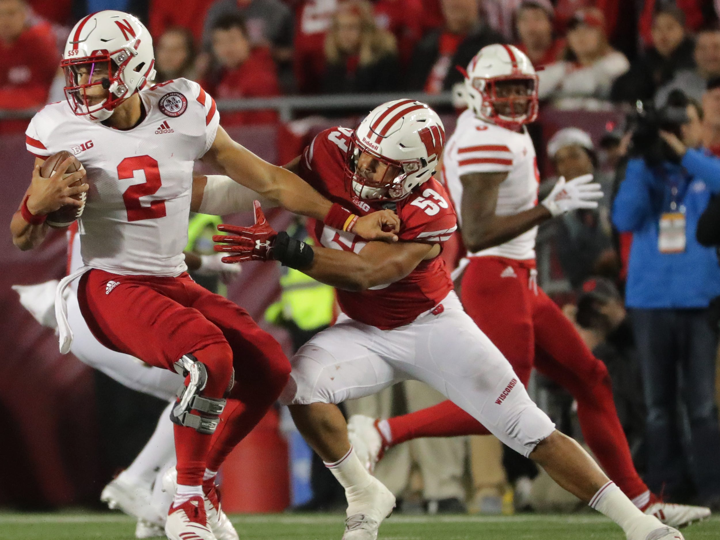 UW linebacker T.J. Edwards is able to get a hold of Nebraska quarterback Adrian Martinez for a sack during the second quarter on Saturday night at Camp Randall Stadium.