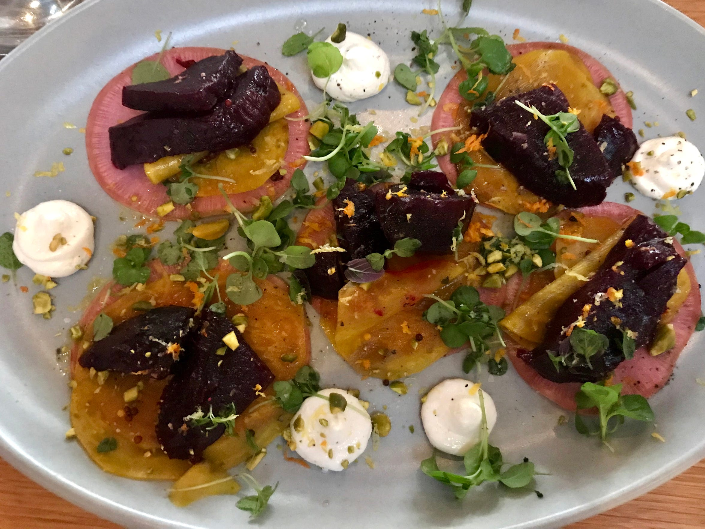 Tre Rivali, the Mediterranean restaurant in the Kimpton Journeyman Hotel at 200 N. Broadway, served a salad of roasted beets with thin pickled beets, cumin yogurt and pistachios, brightened with orange zest.