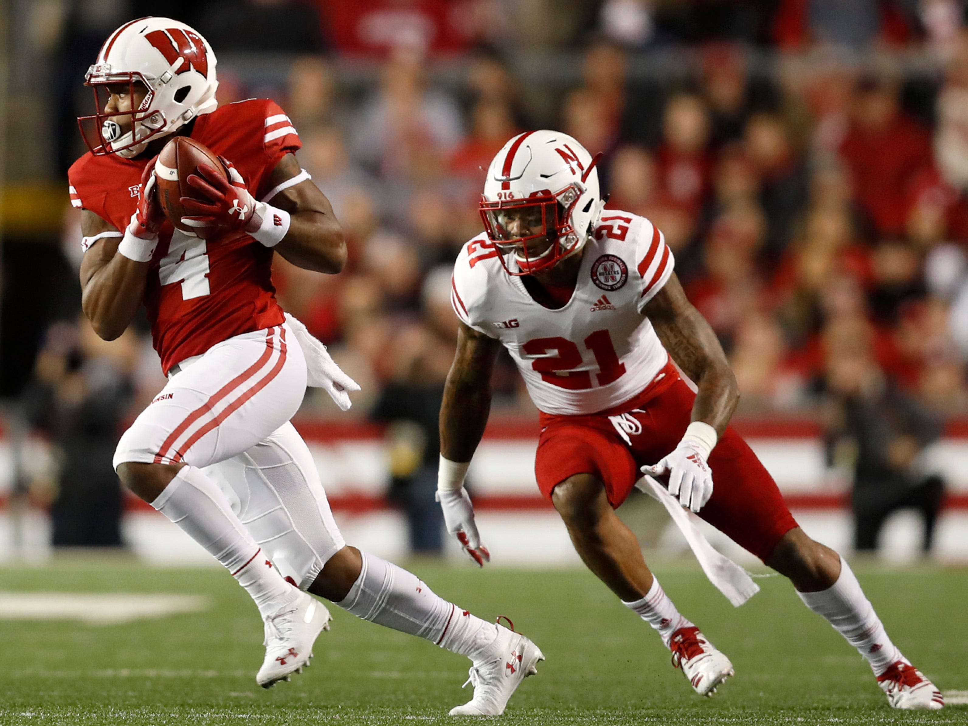 Wisconsin wide receiver A.J. Taylor catches a pass while being covered by Nebraska defensive back Lamar Jackson on Saturday night.