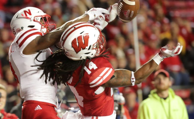 Wisconsin safety D'Cota Dixon breaks up a pass intended for Nebraska wide receiver Stanley Morgan Jr. during the fourth quarter Saturday. Dixon suffered an apparent lower leg injury on the play and didn't return to the game.