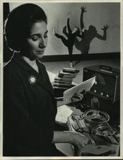 Gregoria Karides Suchy is shown in a 1966 photo from the University of Wisconsin-Milwaukee as the composer of electronic music for a dance choreographed by Myron Nadel, chairman the dance department, and being performed in the background by Joyce Wheeler, identified as a member of the dance theater.