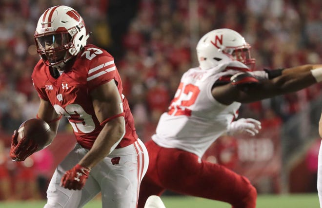 Jonathan Taylor of Wisconsin for a 21-yard touchdown run against Nebraska on Saturday night. Taylor finished with 221 yards on 24 carries with three touchdowns.