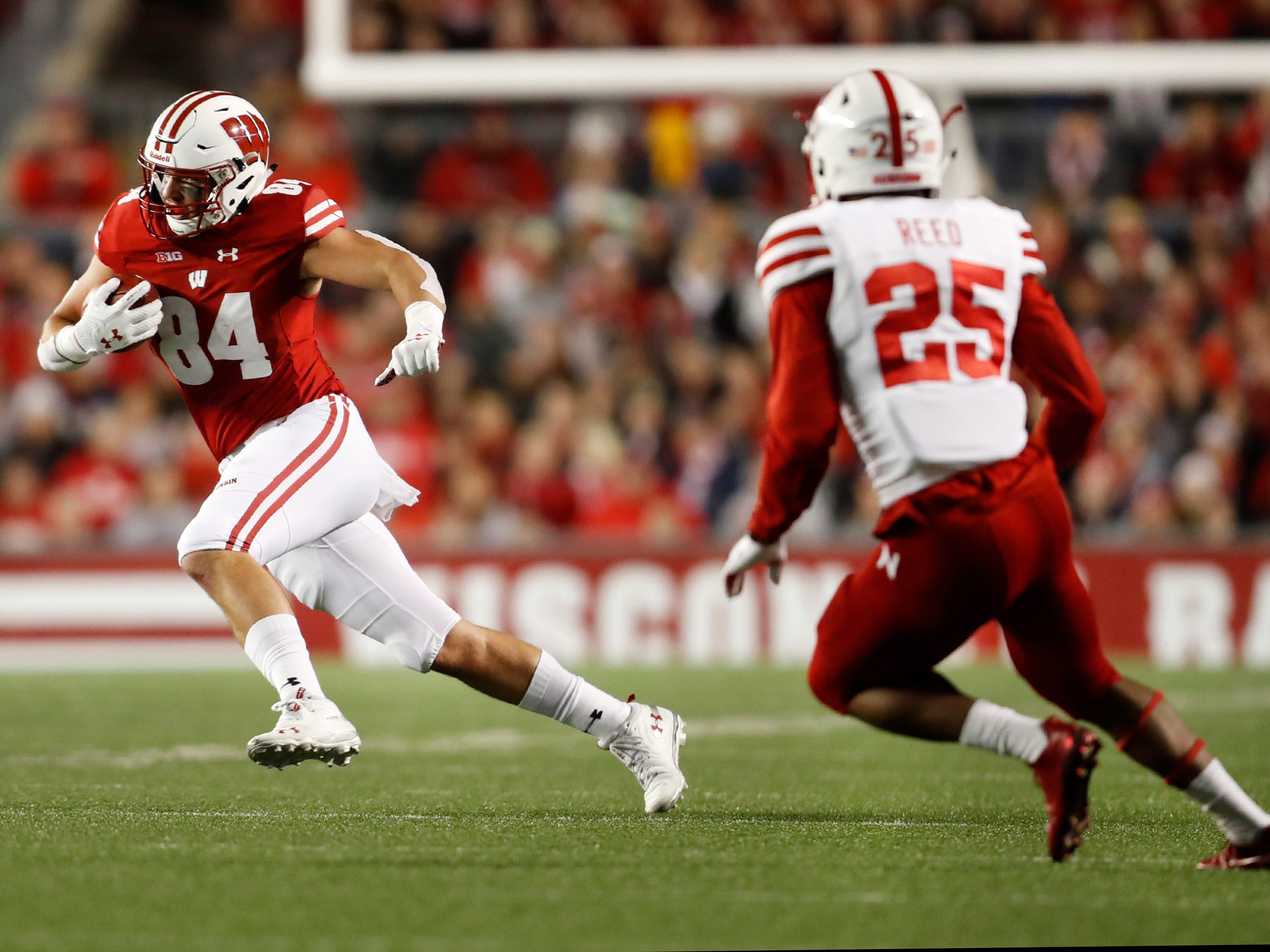 Wisconsin tight end Jake Ferguson finds a seam in Nebraska's defense to pick up a few extra yards after a reception on Saturday night.