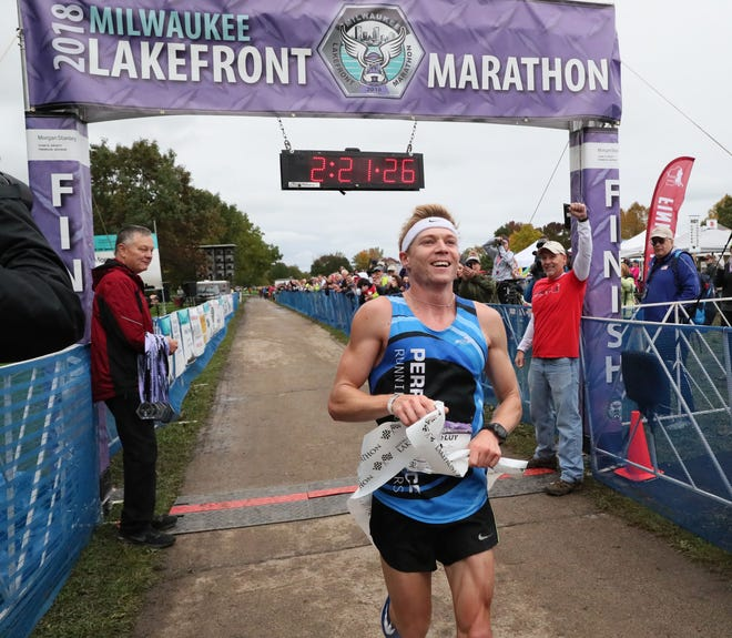 David Luy of Brookfield is all smiles after winning the Lakefront Marathon on Sunday.