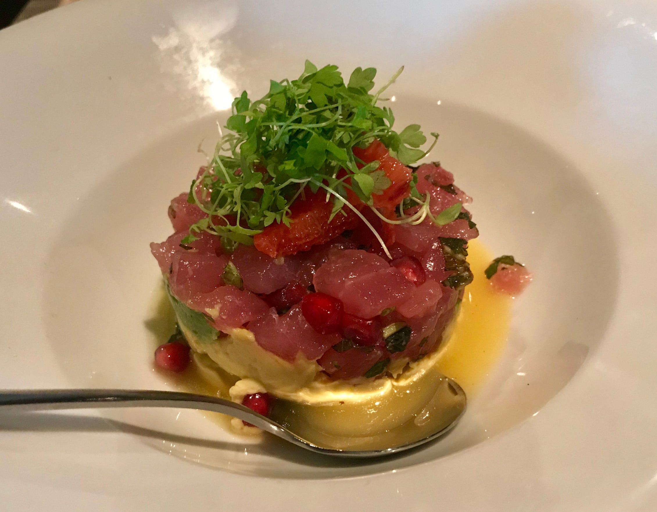 The tuna tartare, flavored with citrus and dotted with pomegranate seeds, is served over avocado at Jake's steakhouse, 21445 W. Gumina Road, Pewaukee.