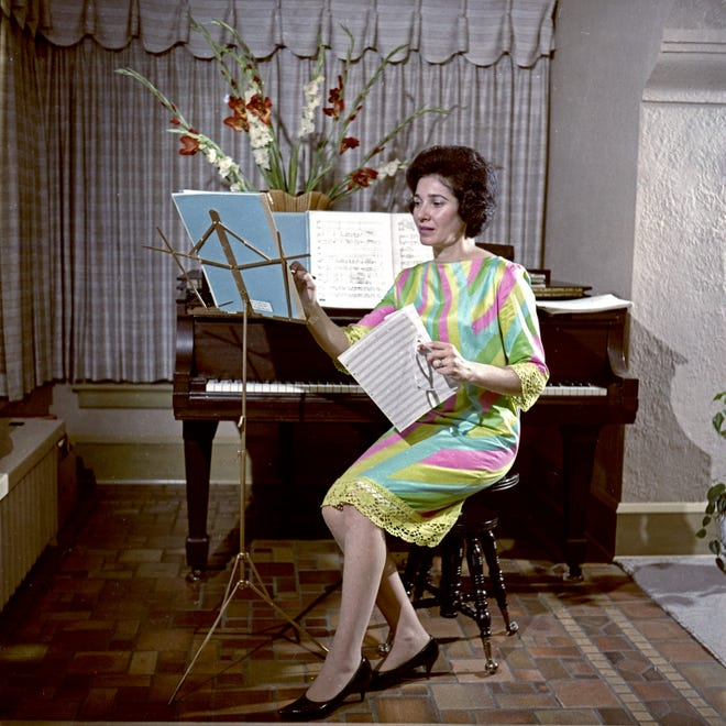 """Gregoria Karides Suchy is shown in a 1966 photo for a story in The Milwaukee Journal on four women composers in Milwaukee. """"Of course, no musician would have flowers on the piano,"""" she said, """"except to oblige a photographer."""""""