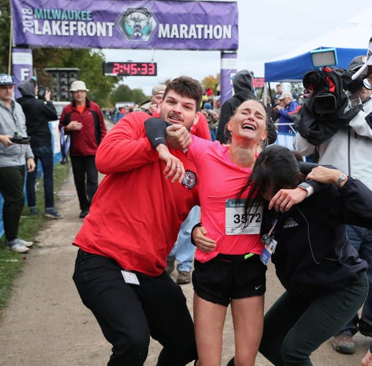 Kameron Burmeister is exhausted after being the top women's finisher at the Lakefront Marathon on Sunday.