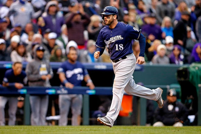 Brewers third baseman Mike Moustakas scores a run on a balk in the sixth inning.