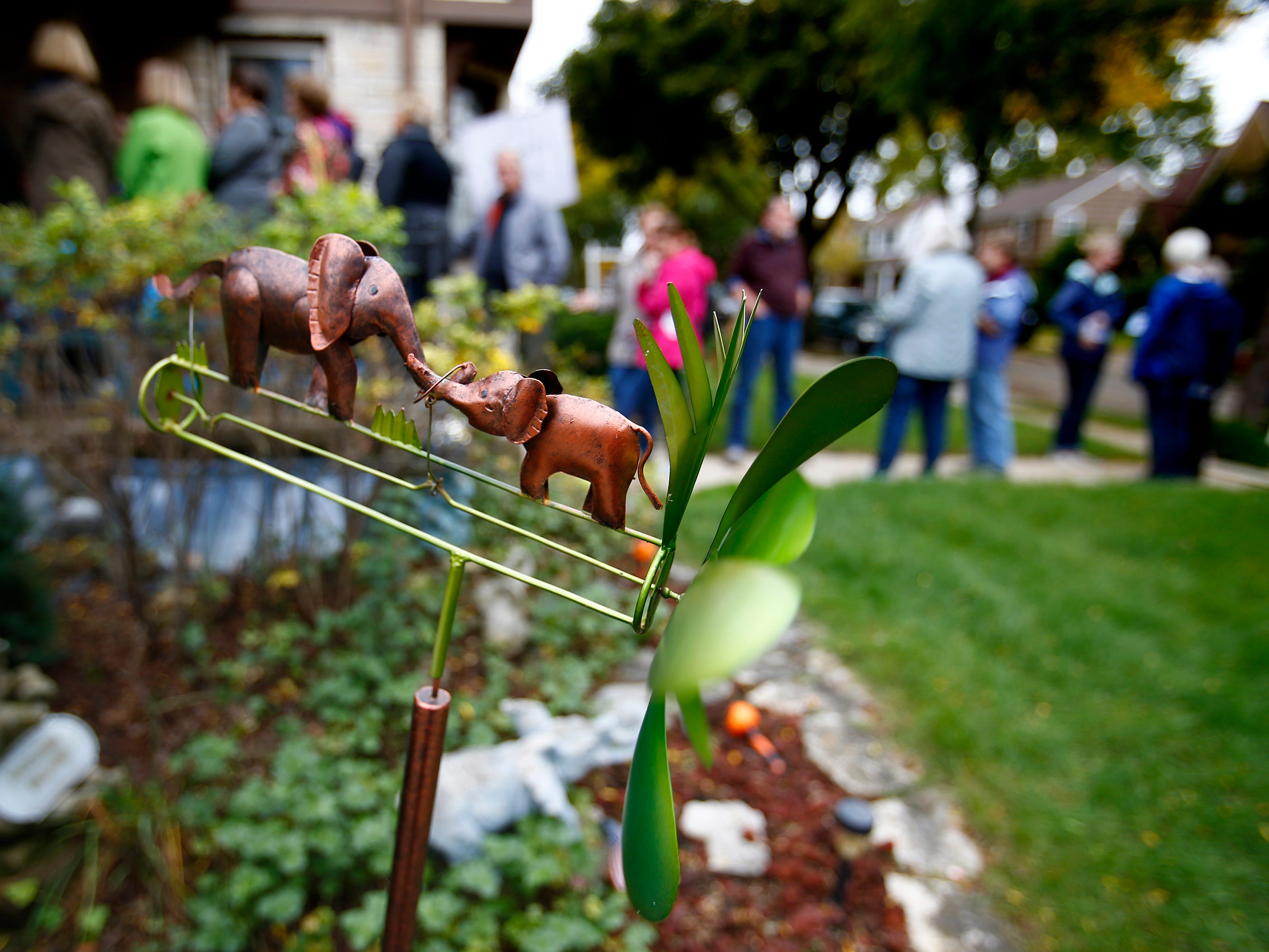 "People line up to tour the self-proclaimed Pachyderm Palace at 8121 Aberdeen Ct. with its elephant collection, like an elephant whirligig trunks and tails waggling in the breeze during the Wauwatosa Historical Society's Tour of Homes, ""Metamorphosis: Homes Re-imagined,"" on Oct. 6."