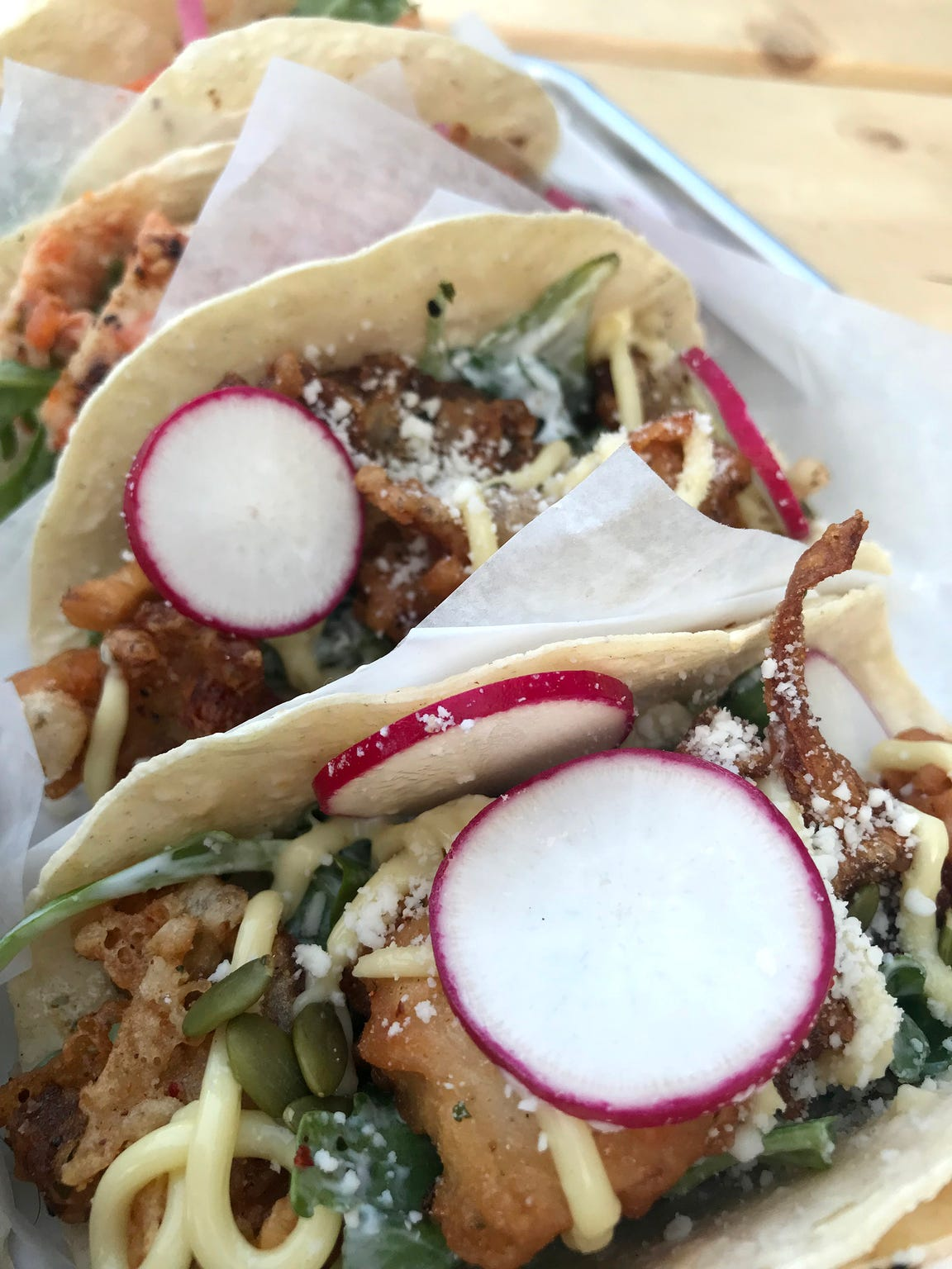 Crisp radish garnishes nearly all of the tacos by the Taco Moto food truck, which is parked outside Boone & Crockett bar at 818 S. Water St. in Milwaukee's Harbor District.