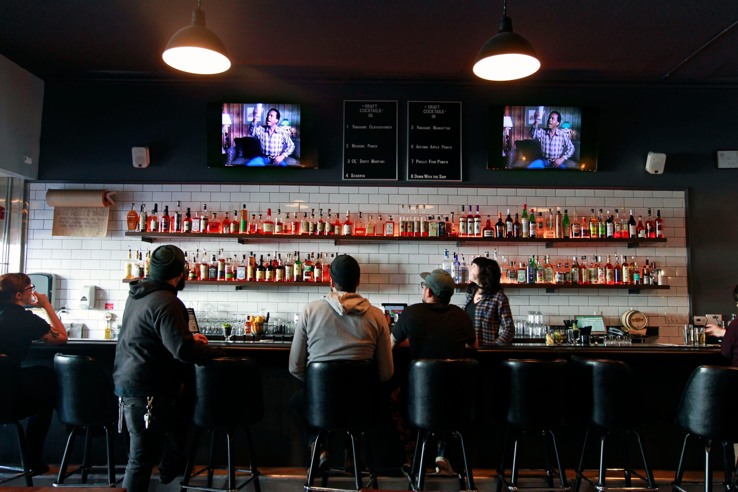 Televisions over the bar at sausagemeister the Vanguard, 2659 S. Kinnickinnic Ave.,  show retro TV programs and vintage wrestling matches.