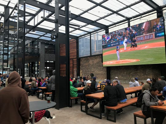 Brewers fans watch the playoff game Sunday afternoon at Fiserv Forum's Oktoberfest. The game was broadcast on the MLB Network, which many fans did not get on their home TVs.