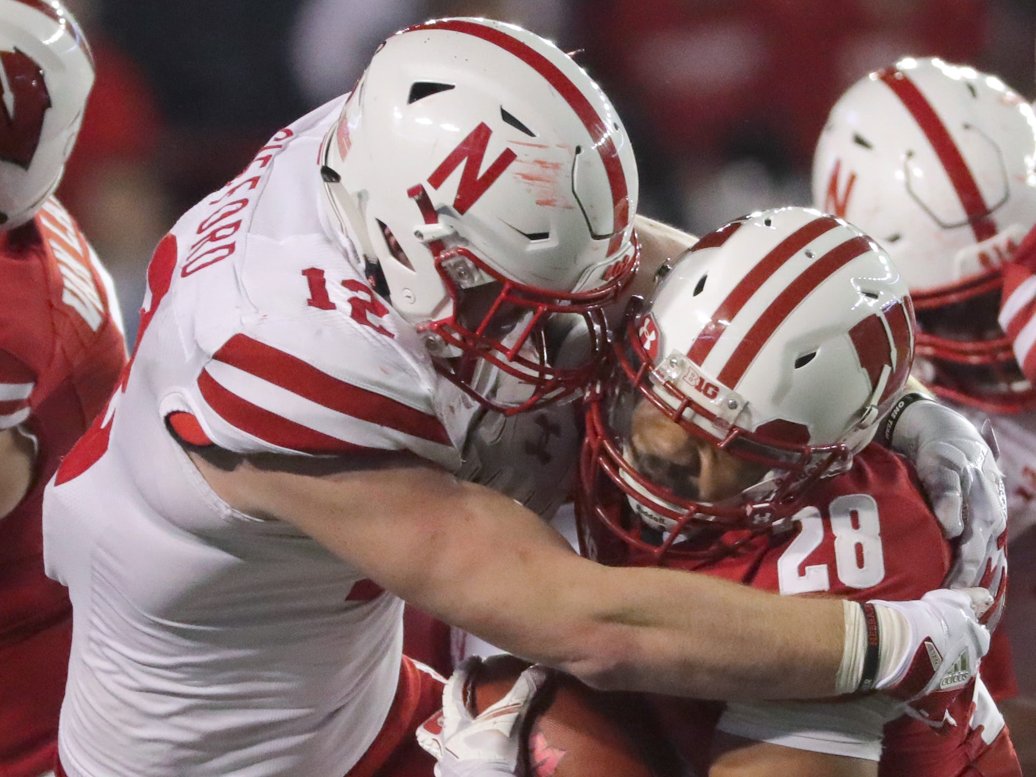 Nebraska linebacker Luke Gifford stuffs Wisconsin running back Taiwan Deal for a minimal gain during the fourth quarter on Saturday night.