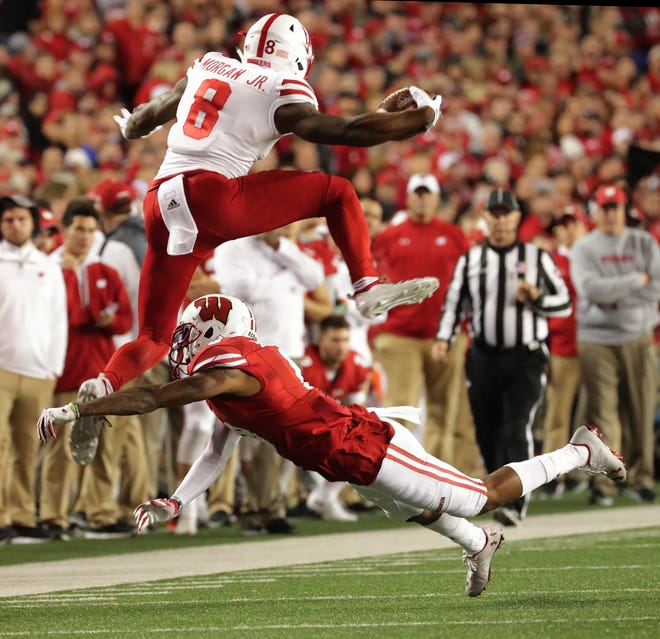 Wisconsin cornerback Deron Harrell, here getting hurdled by Nebraska wide receiver Stanley Morgan Jr., was one of several Badgers in the secondary that did not finish Saturday night's game against the Cornhuskers.
