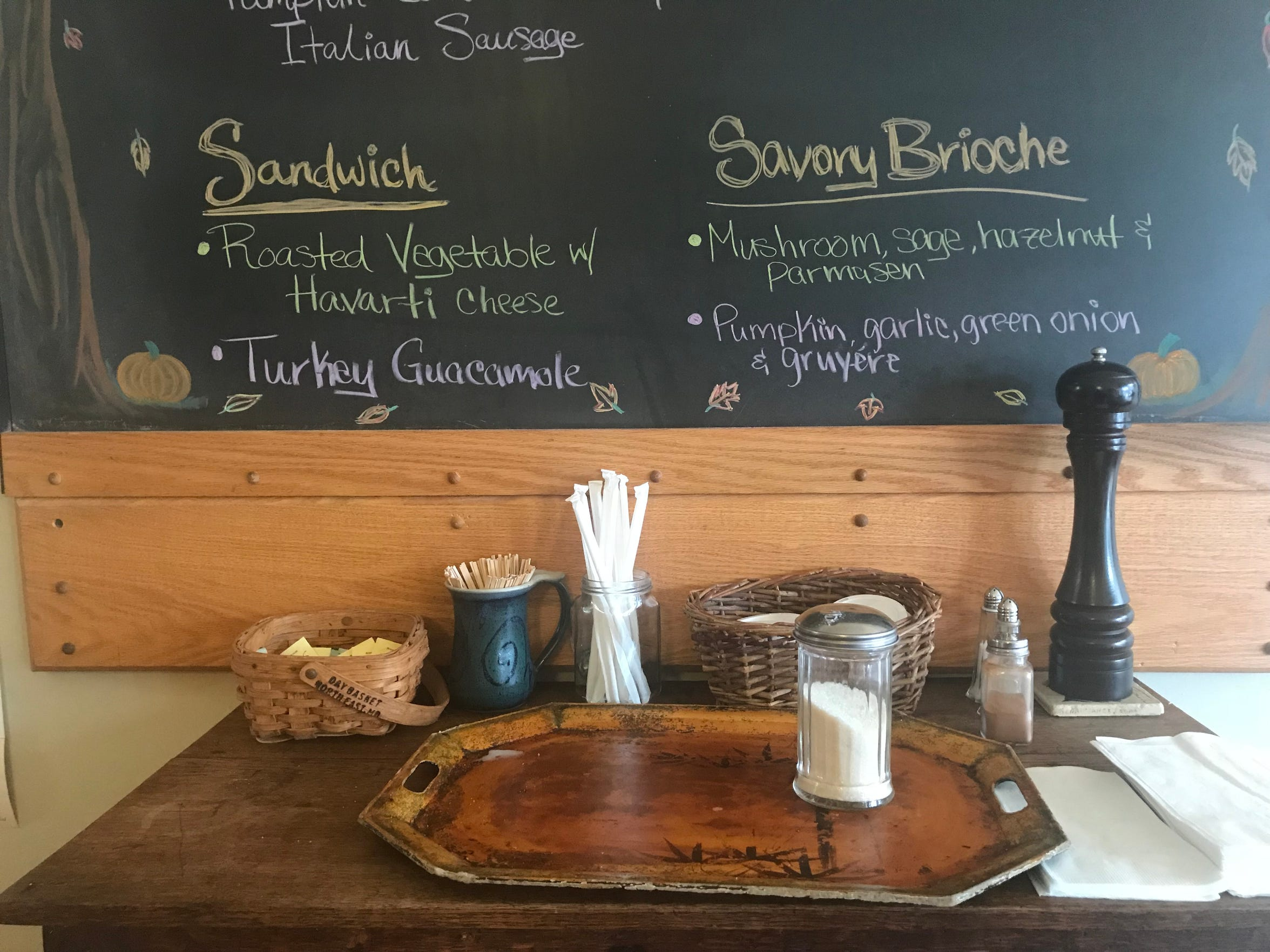 A chalkboard behind the coffee station at Amaranth Bakery & Cafe, 3329 W. Lisbon Ave., lists the daily menu.