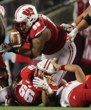Wisconsin nose tackle Olive Sagapolu recovers a fumble by Nebraska quarterback Adrian Martinez during the third quarter on Saturday night.