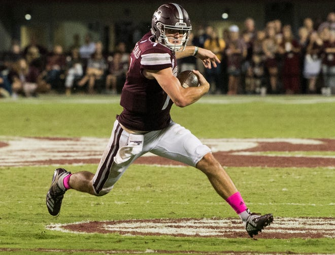 Mississippi State's Nick Fitzgerald (7) makes a move as he runs the ball against  Auburn at Davis Wade Stadium in Starkville, Miss., on Saturday, Oct. 6, 2018. Mississippi State defeated Auburn 23-9.