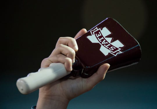 A Mississippi State fan rings their cow bell at Davis Wade Stadium in Starkville, Miss., on Saturday, Oct. 6, 2018. Mississippi State defeated Auburn 23-9.
