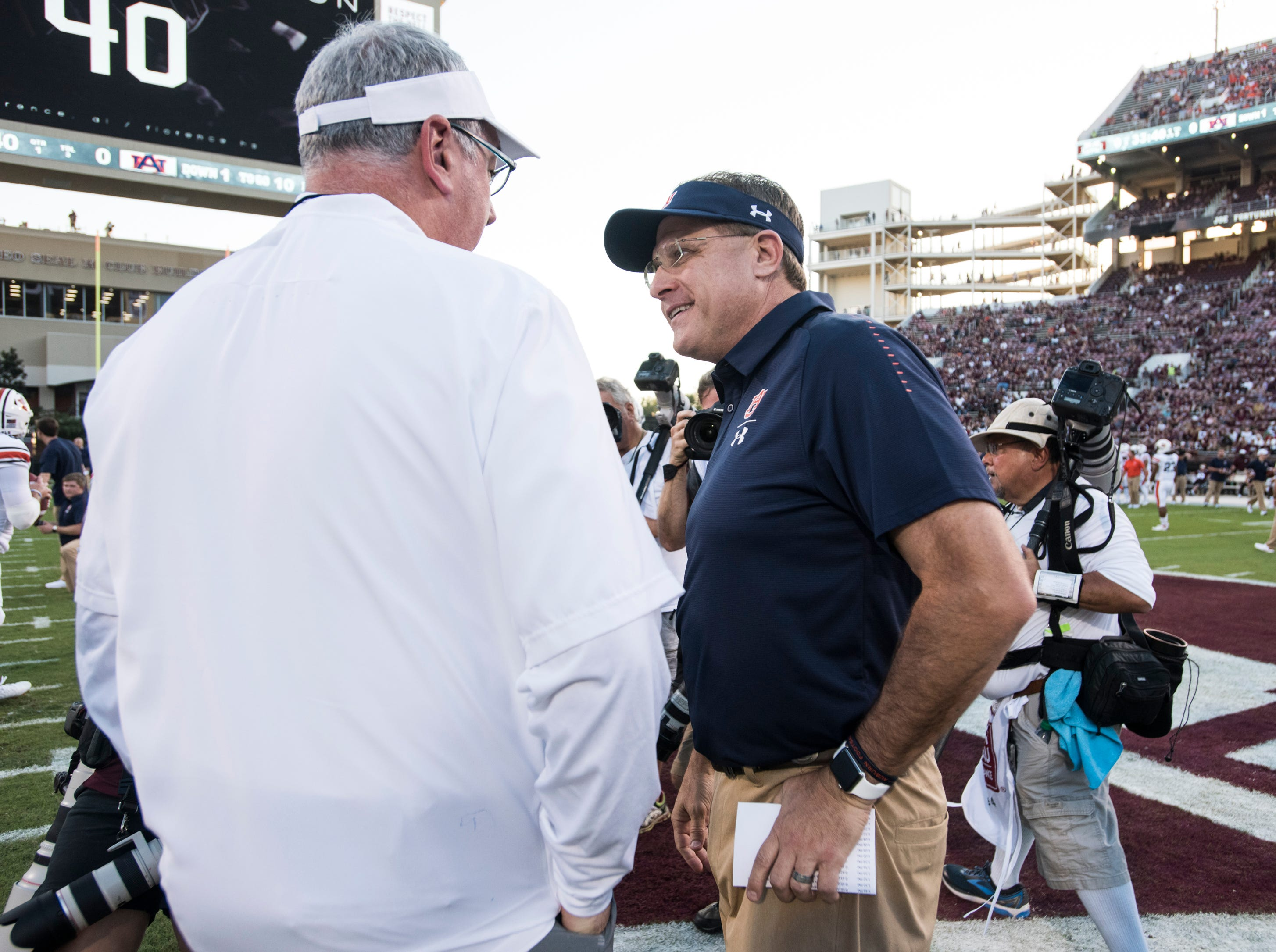 Auburn head coach Gus Malzahn talks with Mississippi State head coach Joe Moorhead as their teams warm up at Davis Wade Stadium in Starkville, Miss., on Saturday, Oct. 6, 2018. Mississippi State defeated Auburn 23-9.