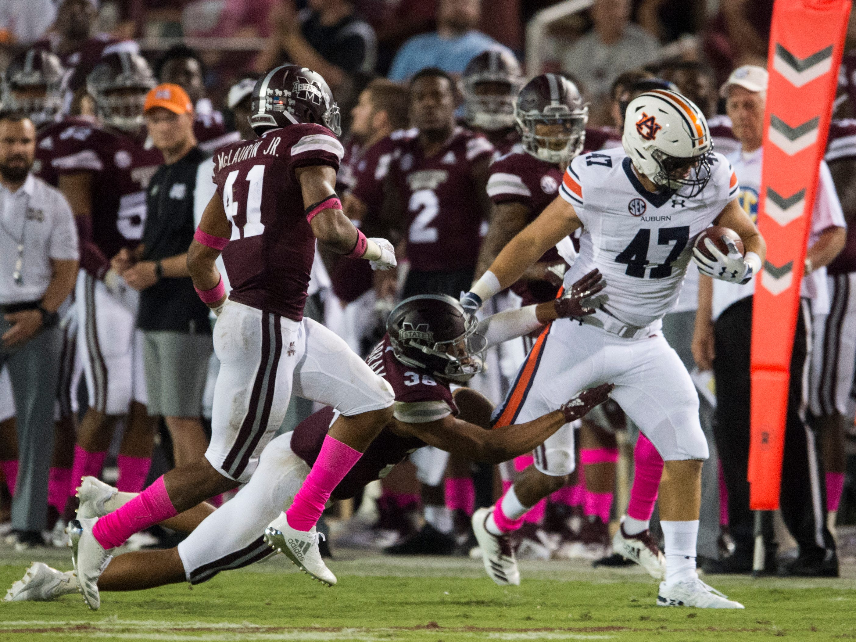 Auburn's John Samuel Shenker (47) is pushed out of bounds by Mississippi State's Johnathan Abram (38) at Davis Wade Stadium in Starkville, Miss., on Saturday, Oct. 6, 2018. Mississippi State defeated Auburn 23-9.