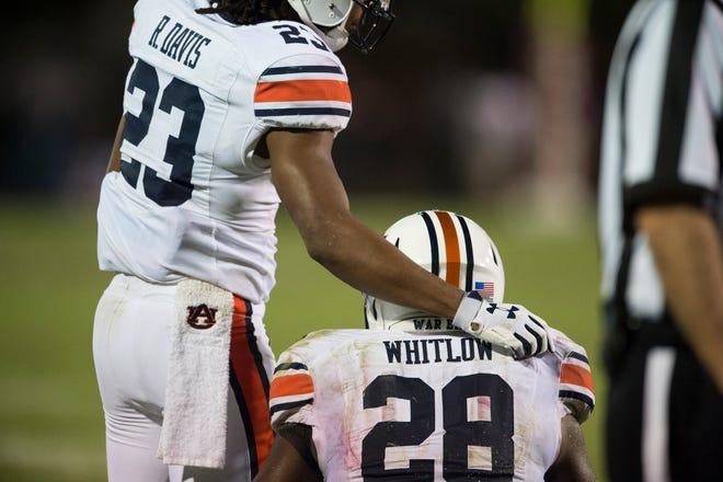 Auburn's Ryan Davis (23) comforts JaTarvious Whitlow (28) after Whitlow's fumble on the goal line at Davis Wade Stadium in Starkville, Miss., on Saturday, Oct. 6, 2018. Mississippi State defeated Auburn 23-9.