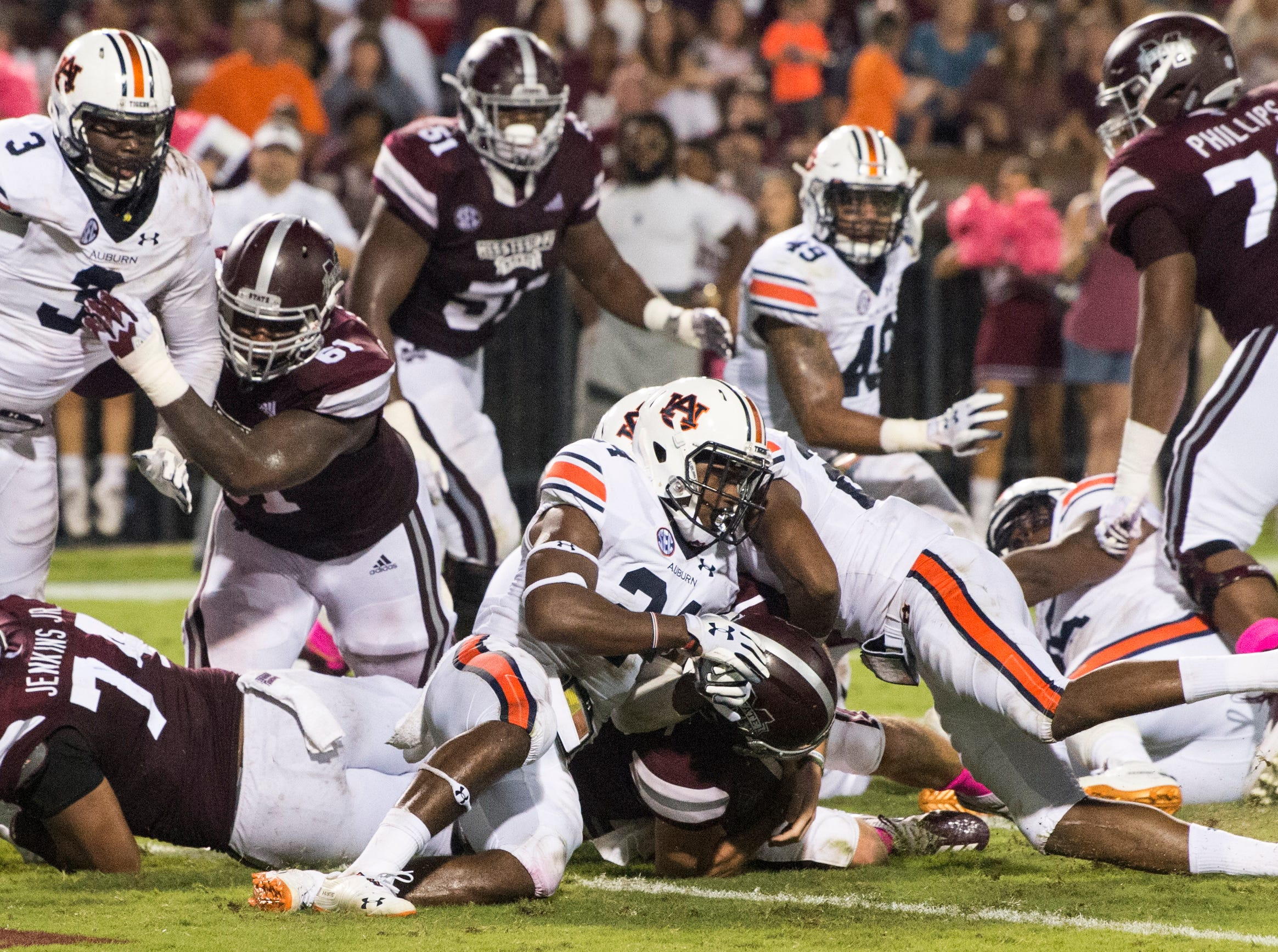 Mississippi State's Nick Fitzgerald (7) pushes the ball into the end zone at the end of the first half at Davis Wade Stadium in Starkville, Miss., on Saturday, Oct. 6, 2018. Mississippi State leads Auburn 13-3 at halftime.