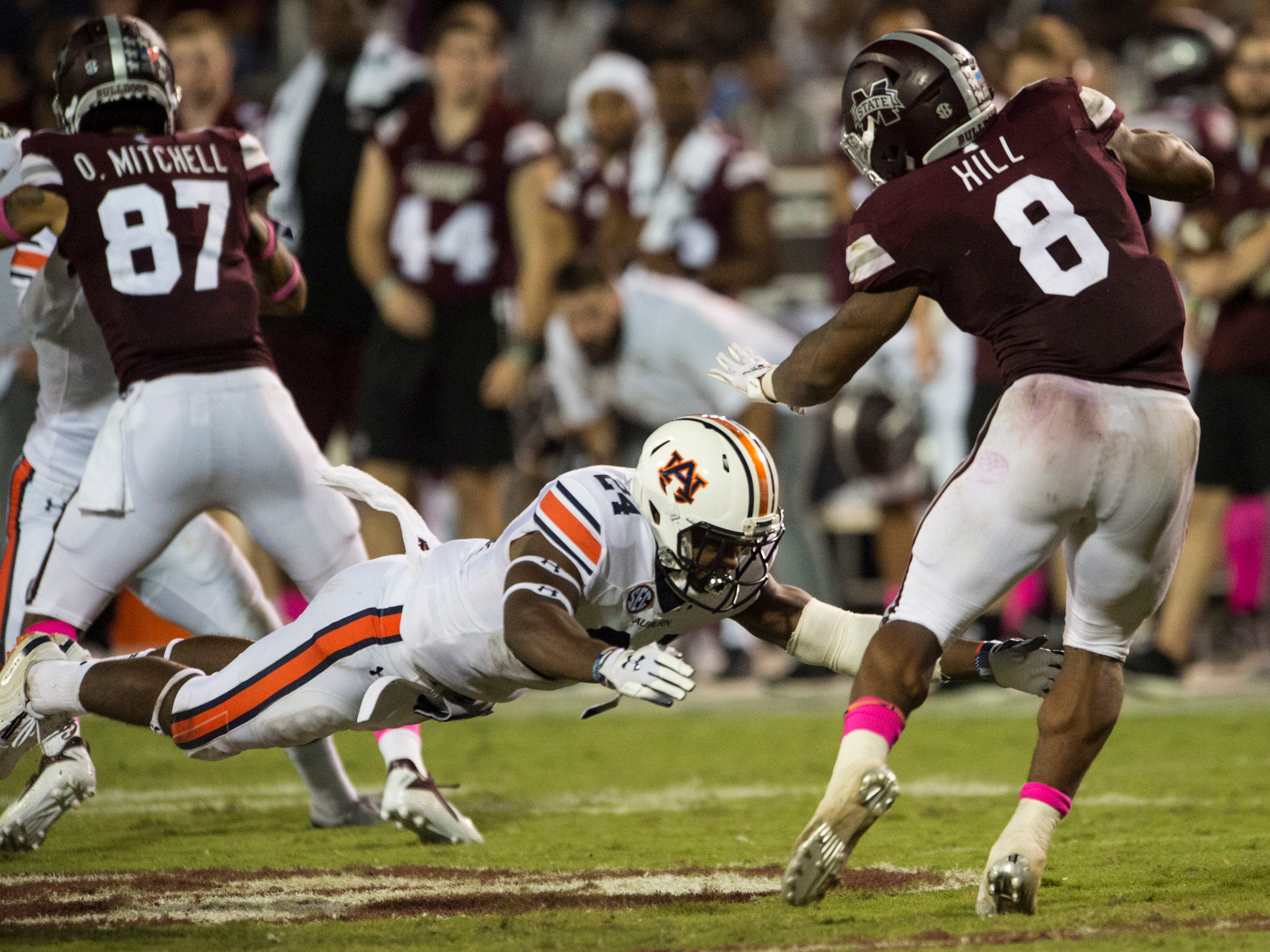 Auburn's Daniel Thomas (24) attempts to tackle Mississippi State's Kylin Hill (8) at Davis Wade Stadium in Starkville, Miss., on Saturday, Oct. 6, 2018. Mississippi State defeated Auburn 23-9.