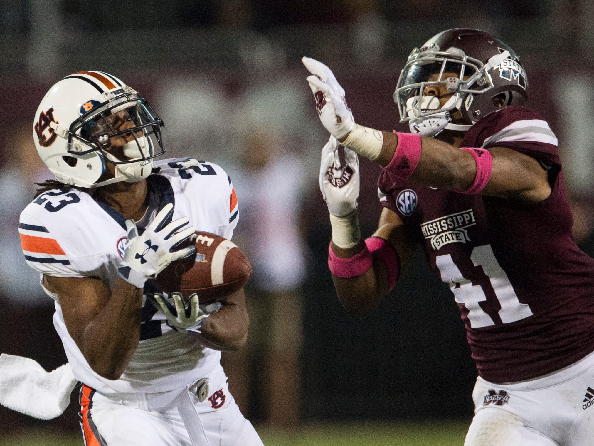 Auburn's Ryan Davis (23) catches a long pass guarded by Mississippi State's Mark McLaurin (41) at Davis Wade Stadium in Starkville, Miss., on Saturday, Oct. 6, 2018. Mississippi State defeated Auburn 23-9.