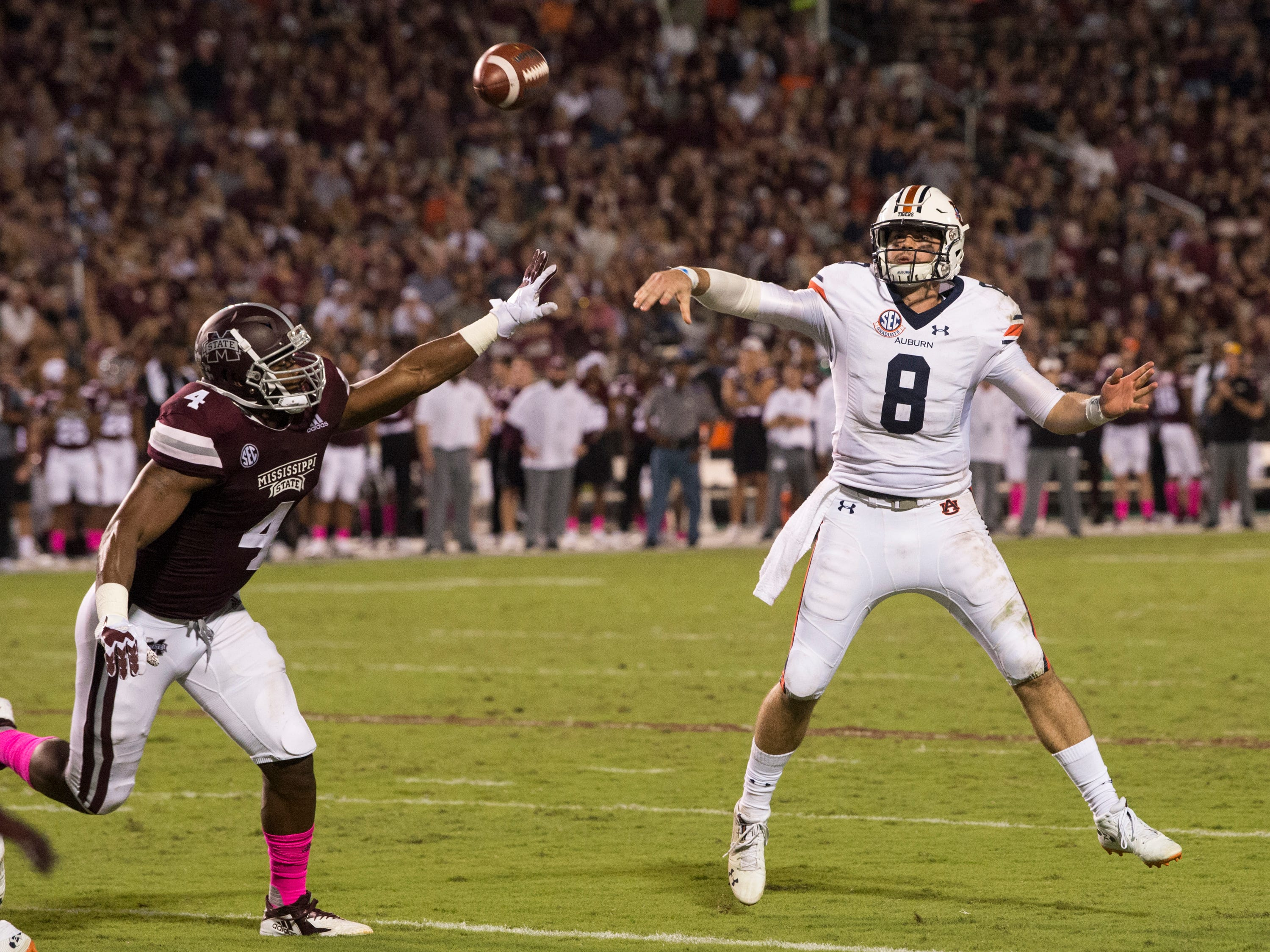 Auburn's Jarrett Stidham (8) throws the ball to the back of the end zone at Davis Wade Stadium in Starkville, Miss., on Saturday, Oct. 6, 2018. Mississippi State defeated Auburn 23-9.