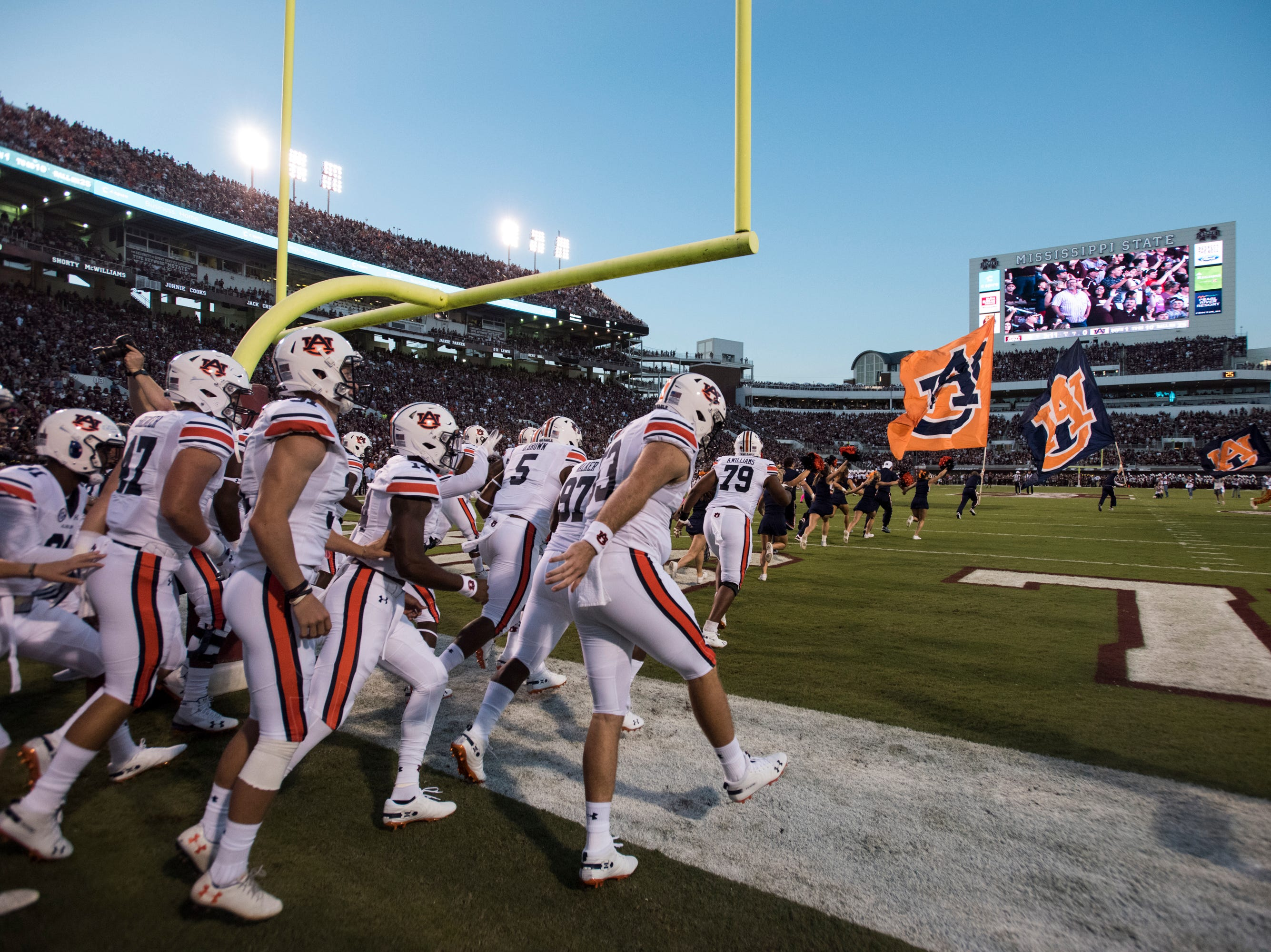 Auburn runs on to the field before the game at Davis Wade Stadium in Starkville, Miss., on Saturday, Oct. 6, 2018. Mississippi State leads Auburn 13-3 at halftime.
