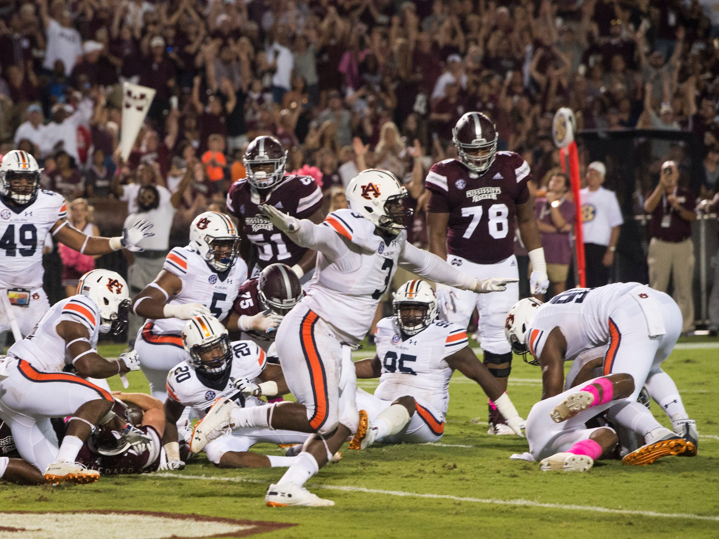 Auburn's Marlon Davidson (3) reacts thinking Auburn defense stopped Mississippi State on the goal line at Davis Wade Stadium in Starkville, Miss., on Saturday, Oct. 6, 2018. Mississippi State defeated Auburn 23-9.