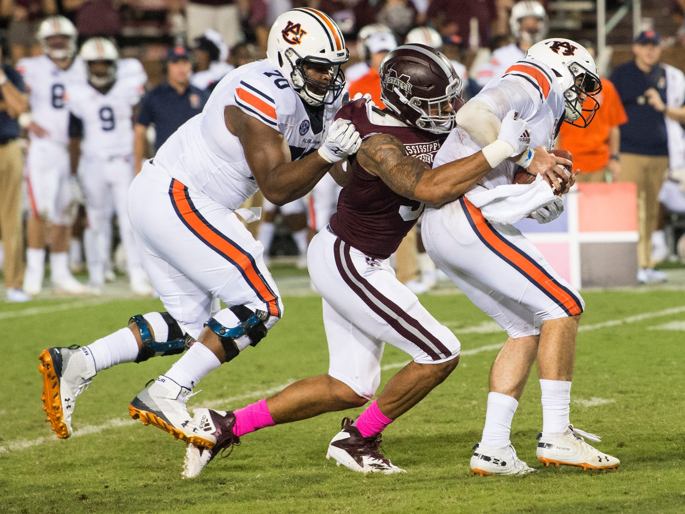 Auburn's Jarrett Stidham (8) is sacked by Mississippi State's Montez Sweat (9) at Davis Wade Stadium in Starkville, Miss., on Saturday, Oct. 6, 2018. Mississippi State defeated Auburn 23-9.