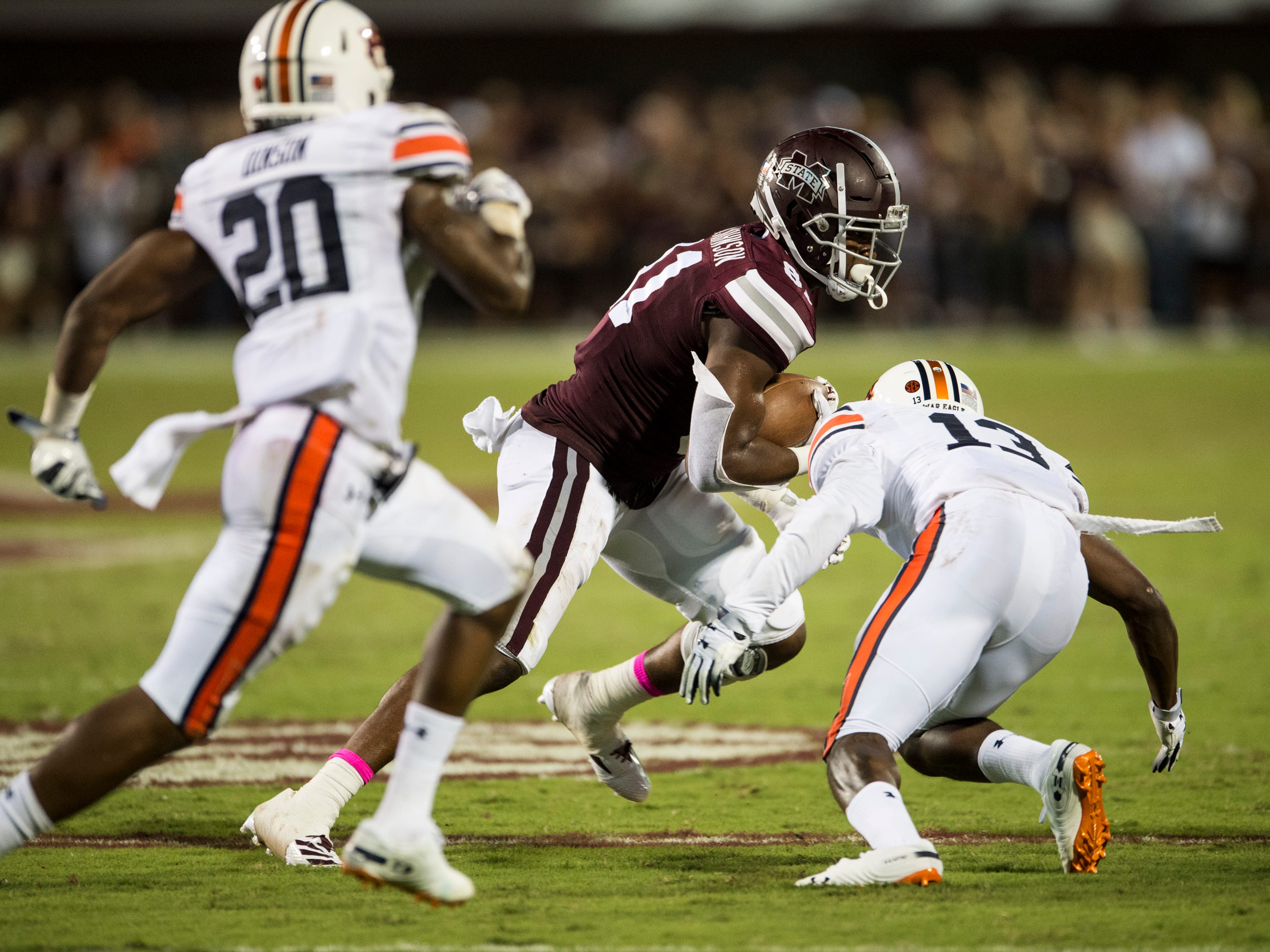 Mississippi State's Justin Johnson (81) is tackled by Auburn's Javaris Davis (13) at Davis Wade Stadium in Starkville, Miss., on Saturday, Oct. 6, 2018. Mississippi State defeated Auburn 23-9.