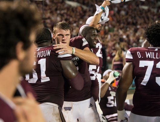 Mississippi State's Nick Fitzgerald (7) celebrates with his teammates at the end of the game at Davis Wade Stadium in Starkville, Miss., on Saturday, Oct. 6, 2018. Mississippi State defeated Auburn 23-9.