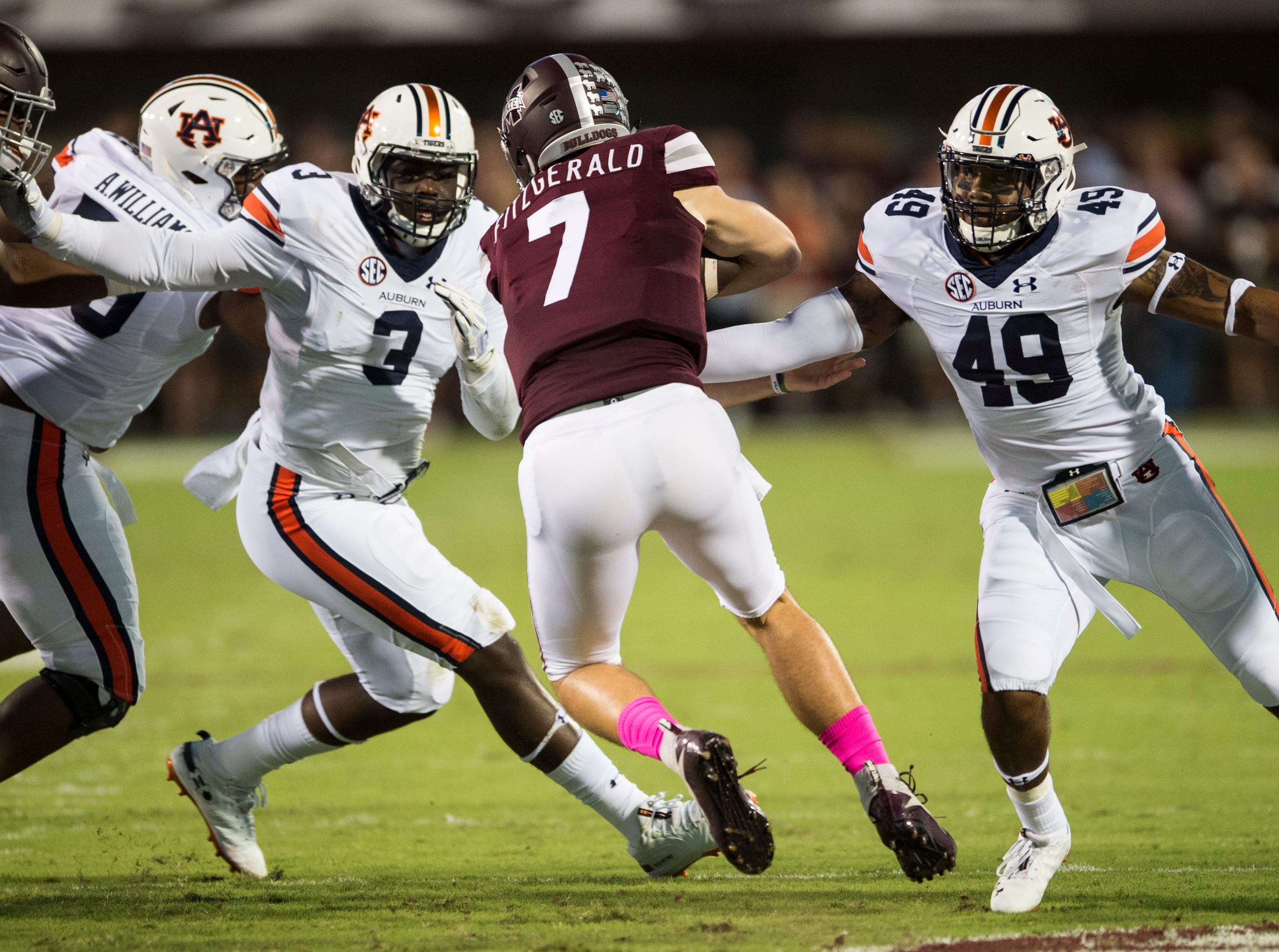 Mississippi State's Nick Fitzgerald (7) runs the ball up the middle against  Auburn at Davis Wade Stadium in Starkville, Miss., on Saturday, Oct. 6, 2018. Mississippi State leads Auburn 13-3 at halftime.