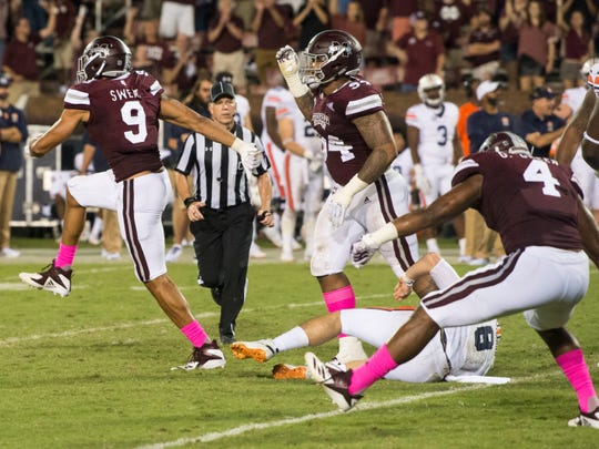 Mississippi State's Montez Sweat (9) reacts after sacking Auburn's Jarrett Stidham (8) on the final drive of the game at Davis Wade Stadium in Starkville, Miss., on Saturday, Oct. 6, 2018. Mississippi State defeated Auburn 23-9.