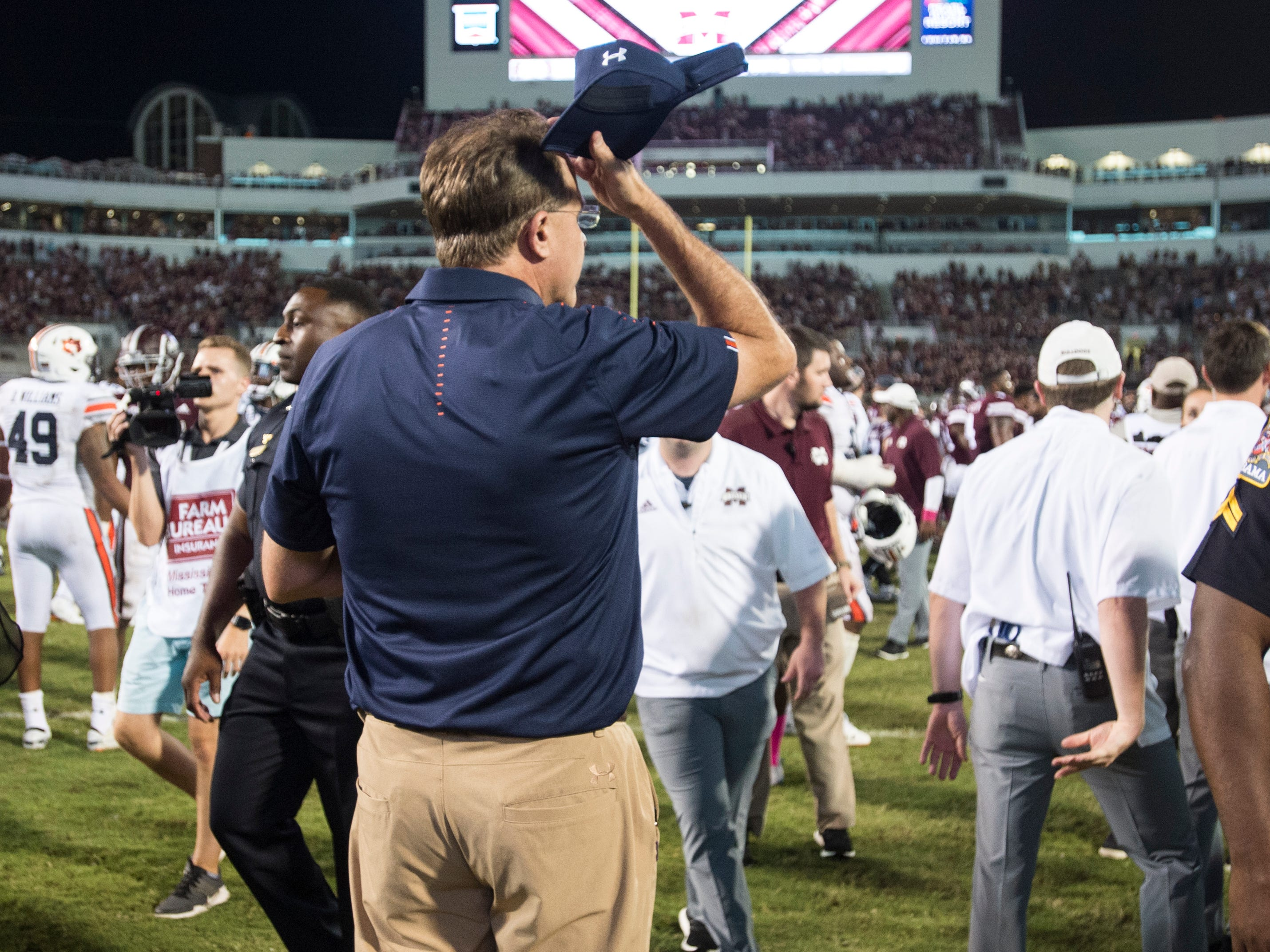 Auburn head coach Gus Malzahn adjusts his hat after the game at Davis Wade Stadium in Starkville, Miss., on Saturday, Oct. 6, 2018. Mississippi State defeated Auburn 23-9.