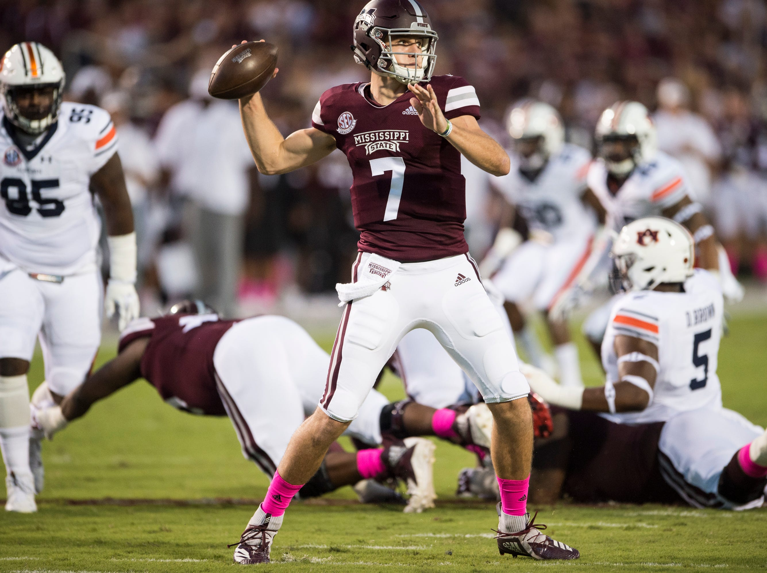 Mississippi State's Nick Fitzgerald (7) throws a screen pass against  Auburn at Davis Wade Stadium in Starkville, Miss., on Saturday, Oct. 6, 2018. Mississippi State leads Auburn 13-3 at halftime.