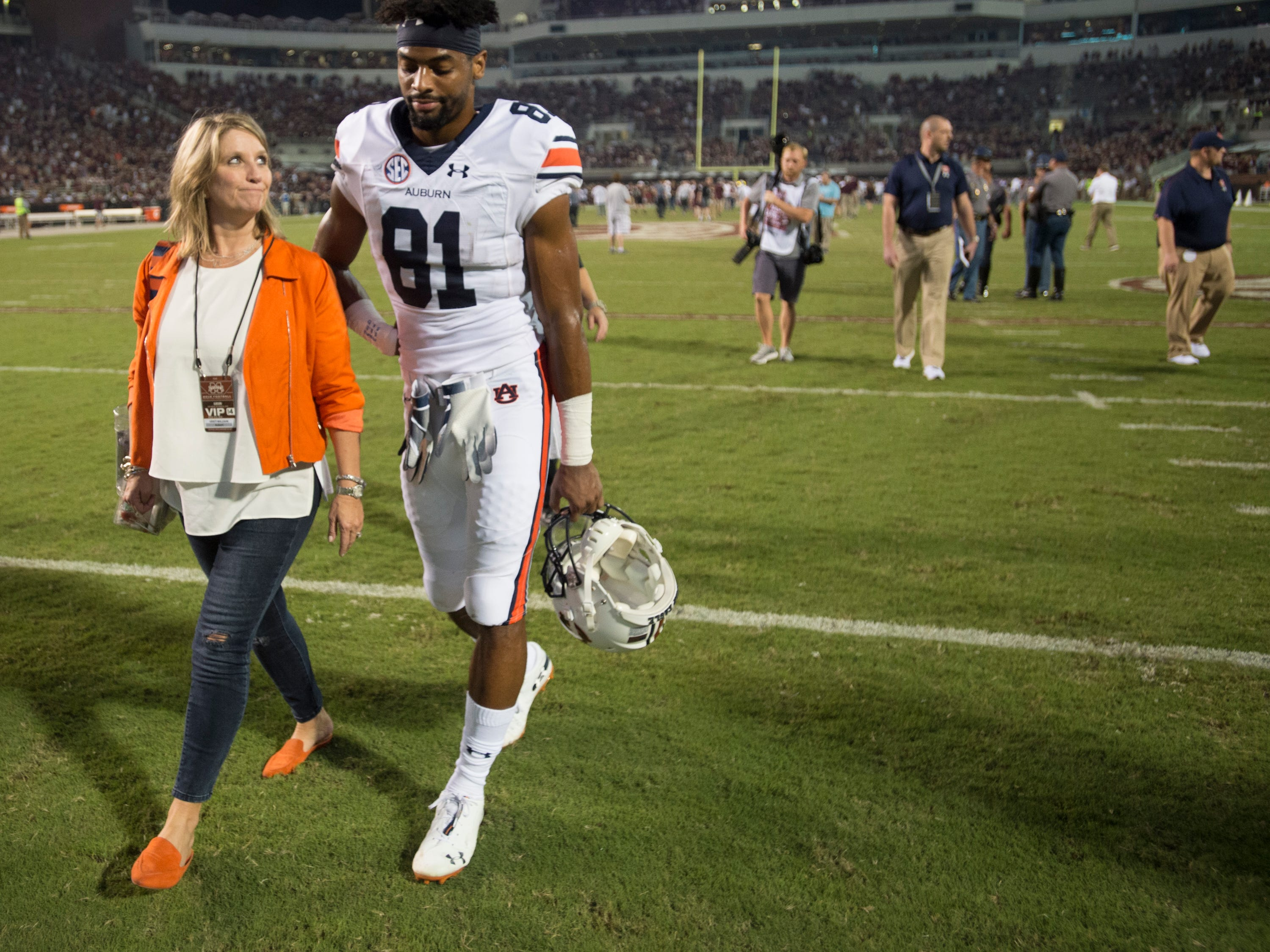 Kristi Malzahn, wife of Auburn head coach Gus Malzahn, talks with Auburn's Darius Slayton (81) as they walk off the field after the game at Davis Wade Stadium in Starkville, Miss., on Saturday, Oct. 6, 2018. Mississippi State defeated Auburn 23-9.