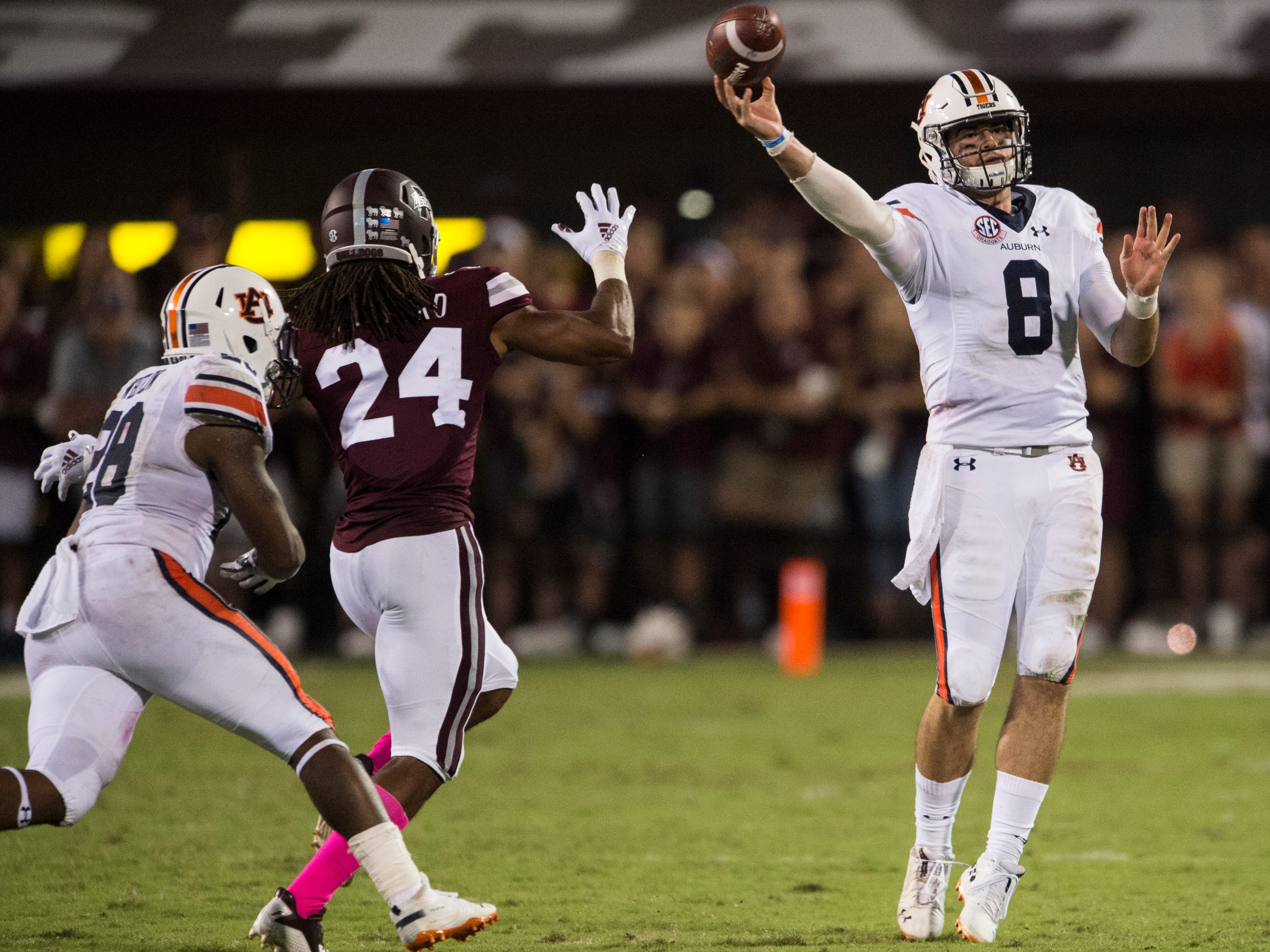 Auburn's Jarrett Stidham (8) throws the ball down field against Mississippi State at Davis Wade Stadium in Starkville, Miss., on Saturday, Oct. 6, 2018. Mississippi State defeated Auburn 23-9.