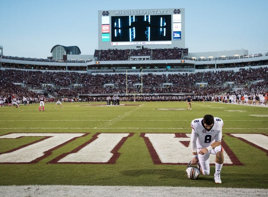 Auburn's Jarrett Stidham (8) kneels in the end zone before the start of the game at Davis Wade Stadium in Starkville, Miss., on Saturday, Oct. 6, 2018. Mississippi State defeated Auburn 23-9.