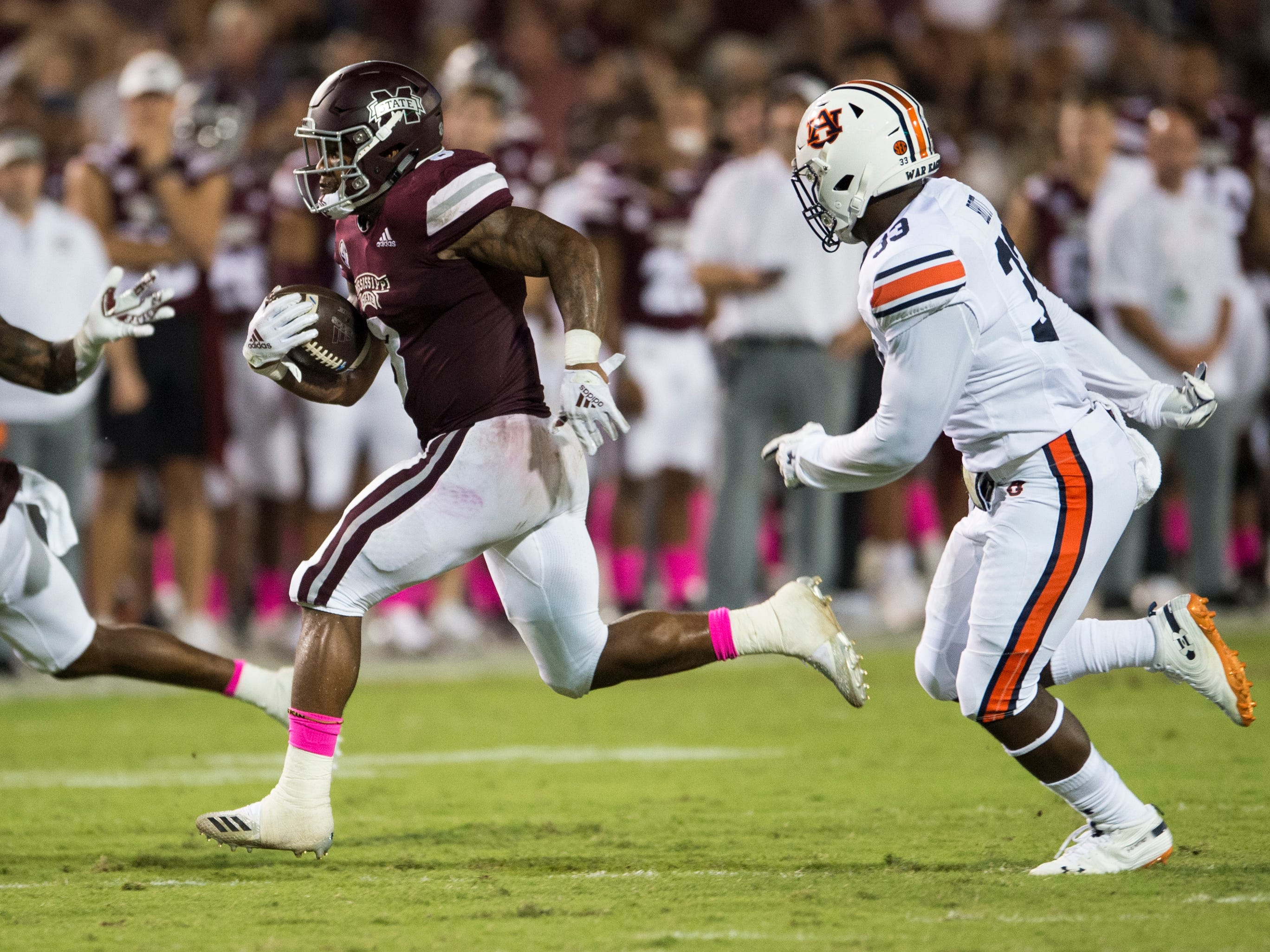 Mississippi State's Kylin Hill (8) runs the ball against Mississippi State at Davis Wade Stadium in Starkville, Miss., on Saturday, Oct. 6, 2018. Mississippi State defeated Auburn 23-9.