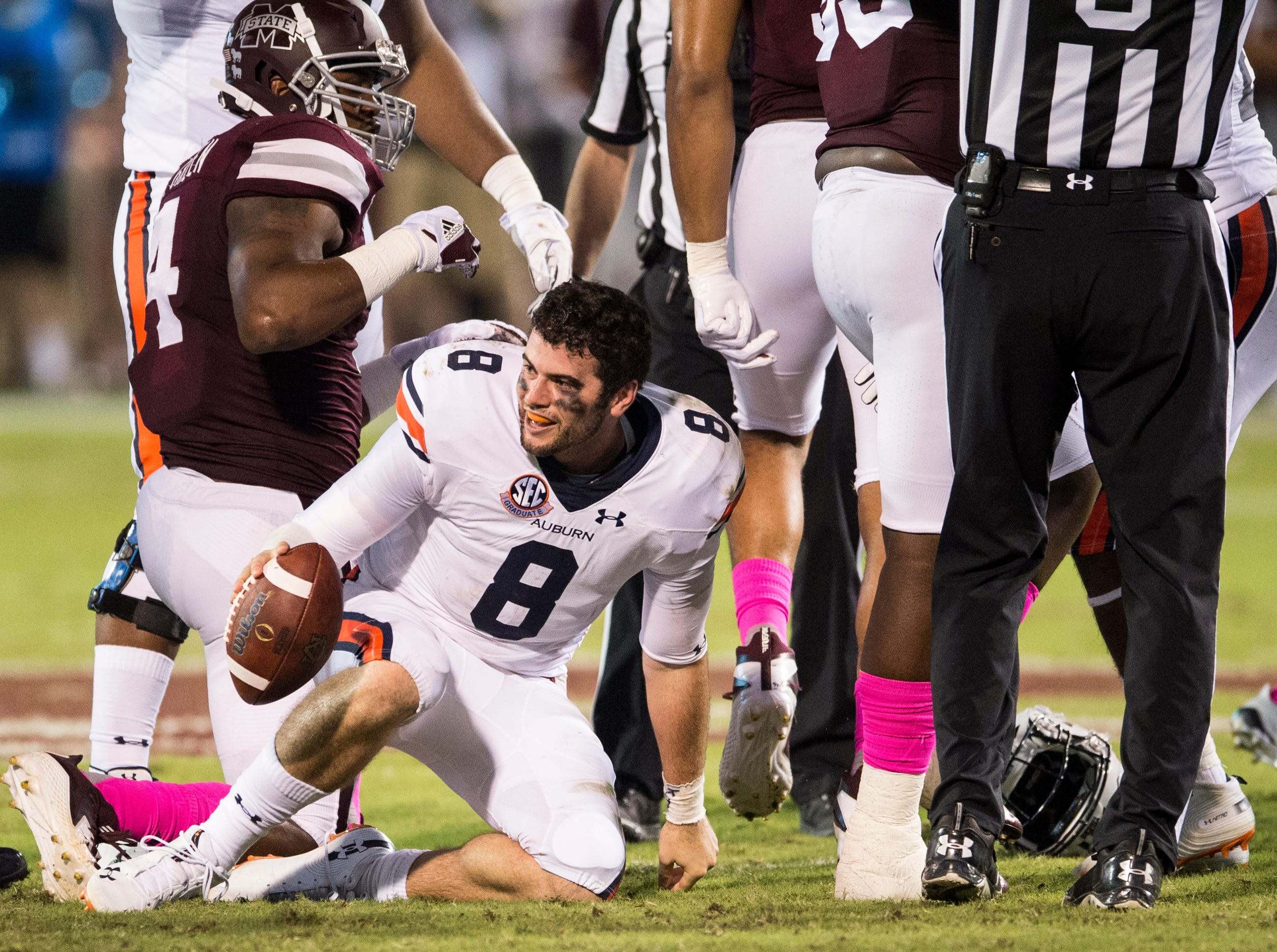 Auburn's Jarrett Stidham (8) gets up after losing his helmet against Mississippi State at Davis Wade Stadium in Starkville, Miss., on Saturday, Oct. 6, 2018. Mississippi State leads Auburn 13-3 at halftime.